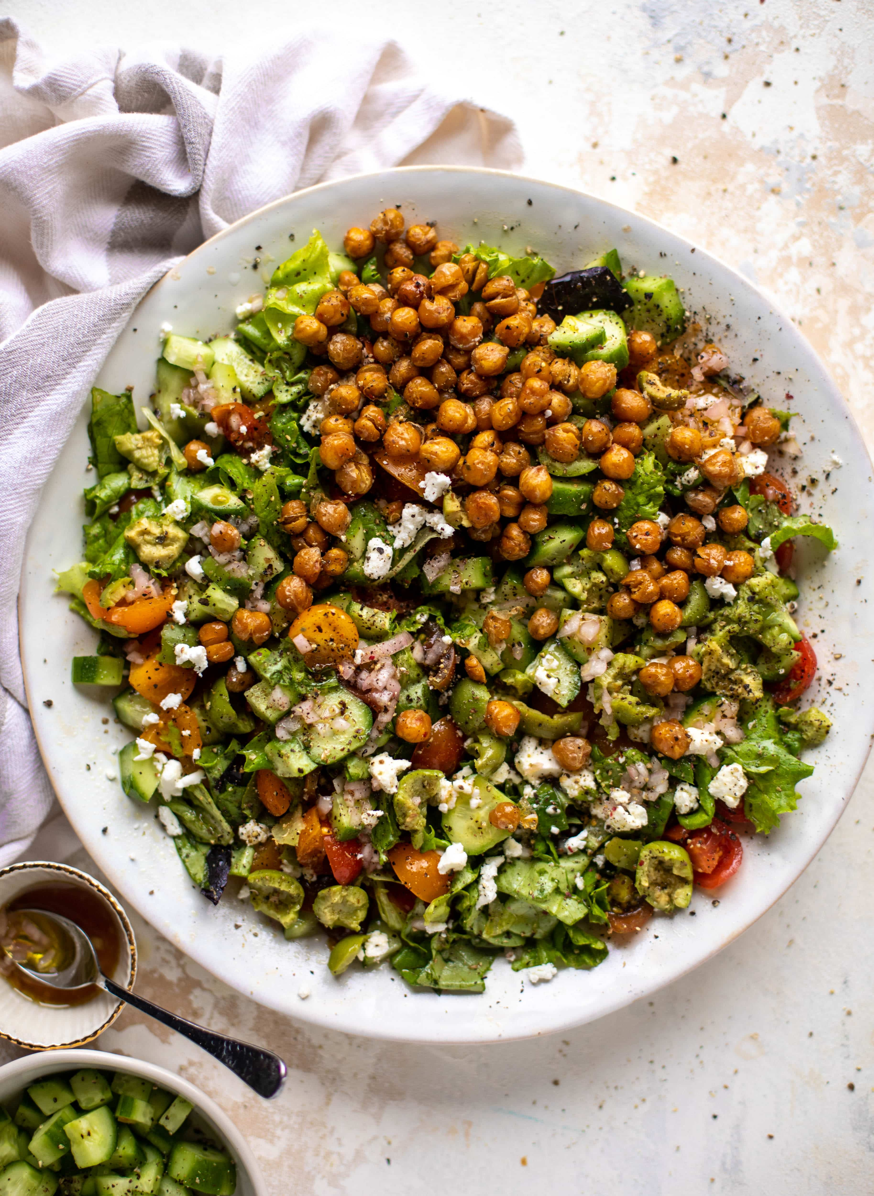 This crispy chickpea chopped salad is super simple and loaded with flavor. It's an incredible side or starter and a huge crowd pleaser!