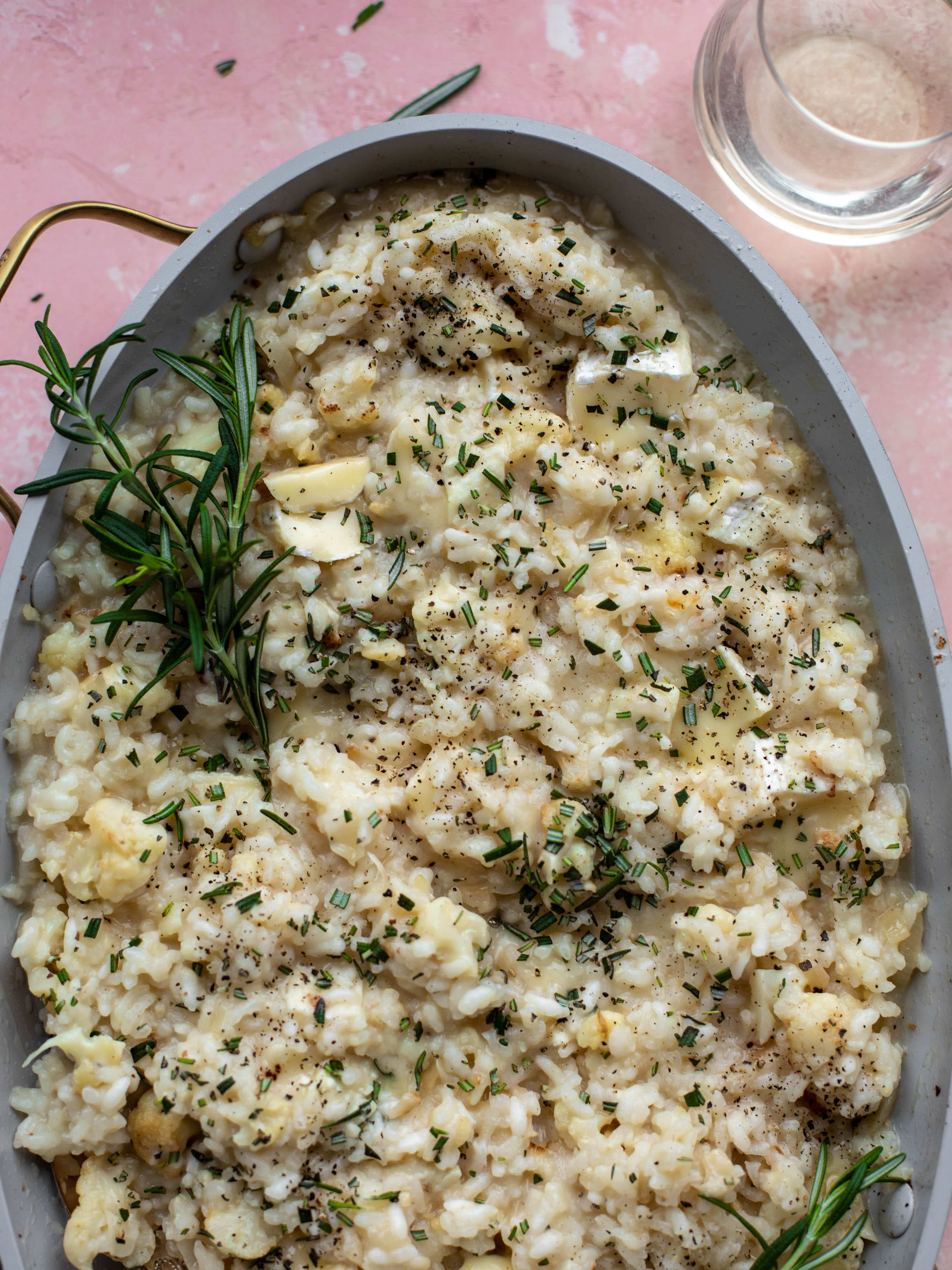 This baked risotto is delicious and so much easier than the stovetop version! Toasted cauliflower, brie cheese and rosemary make this taste incredible.