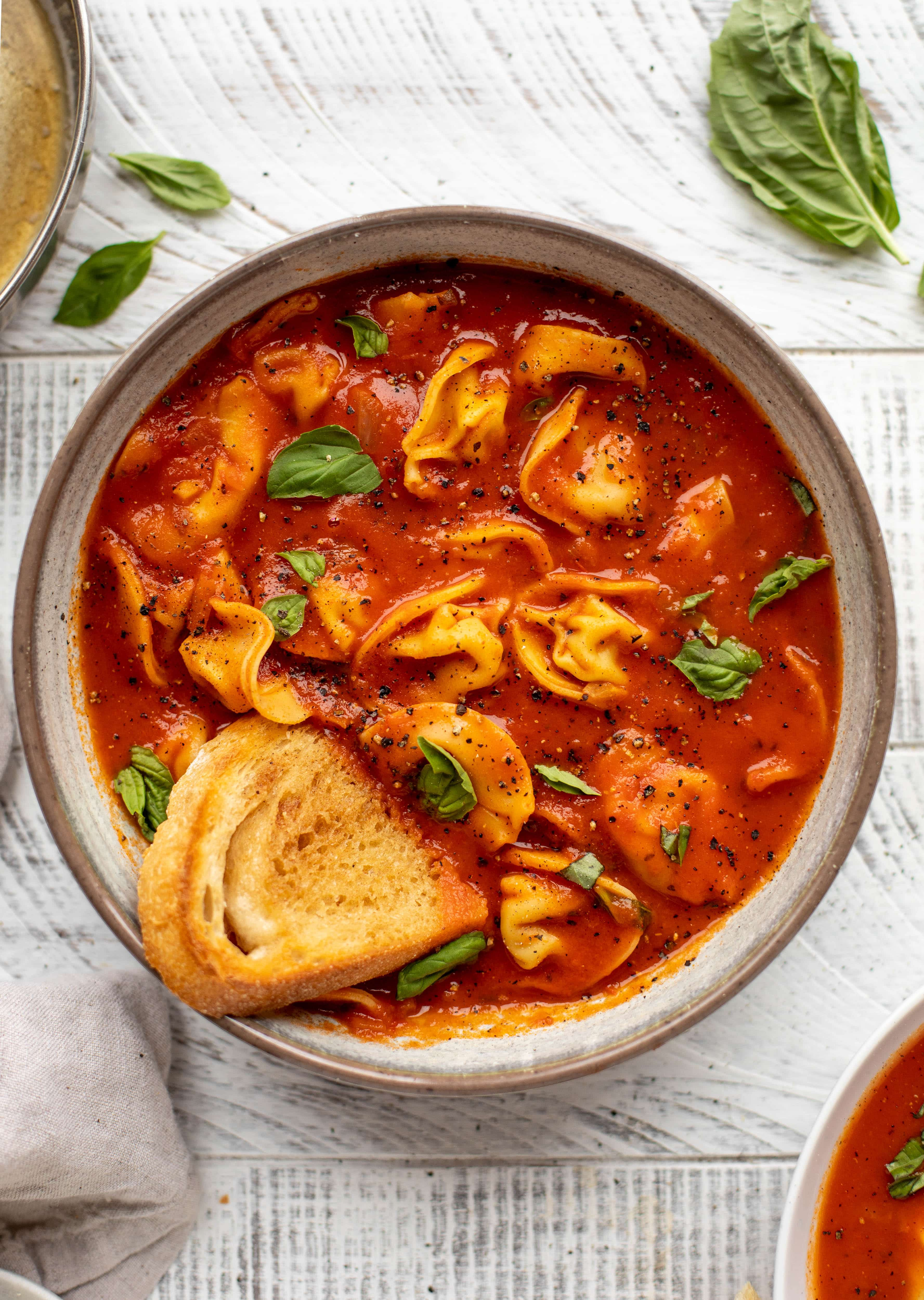 This curried tomato tortellini soup has so much flavor! Serve with cheesy tortellini and brown butter garlic toasts for the perfect weeknight meal.
