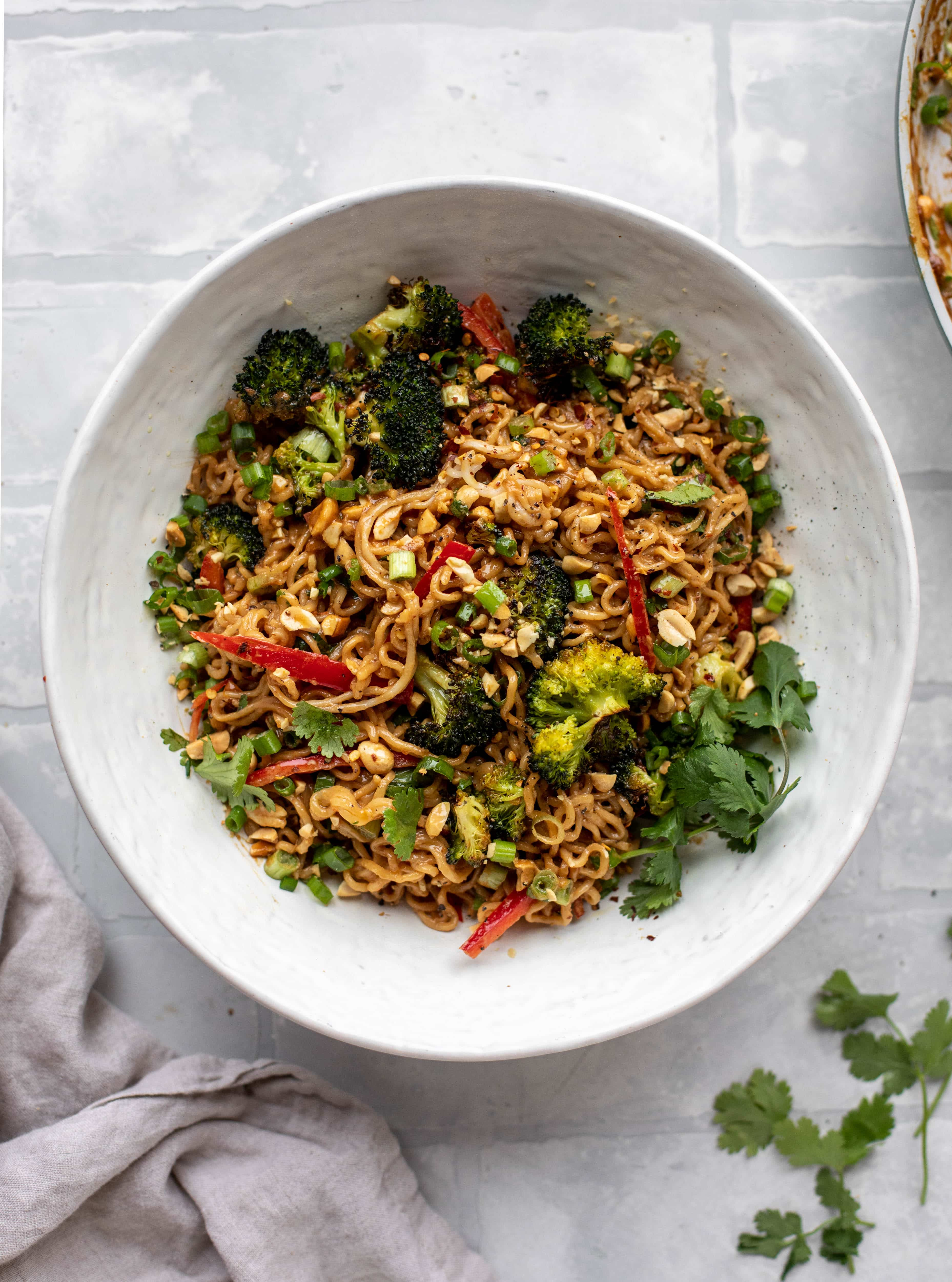 These are the most delicious peanut noodles! Tossed with roasted broccoli, red peppers, scallions, peanuts and an incredibly flavorful sauce!