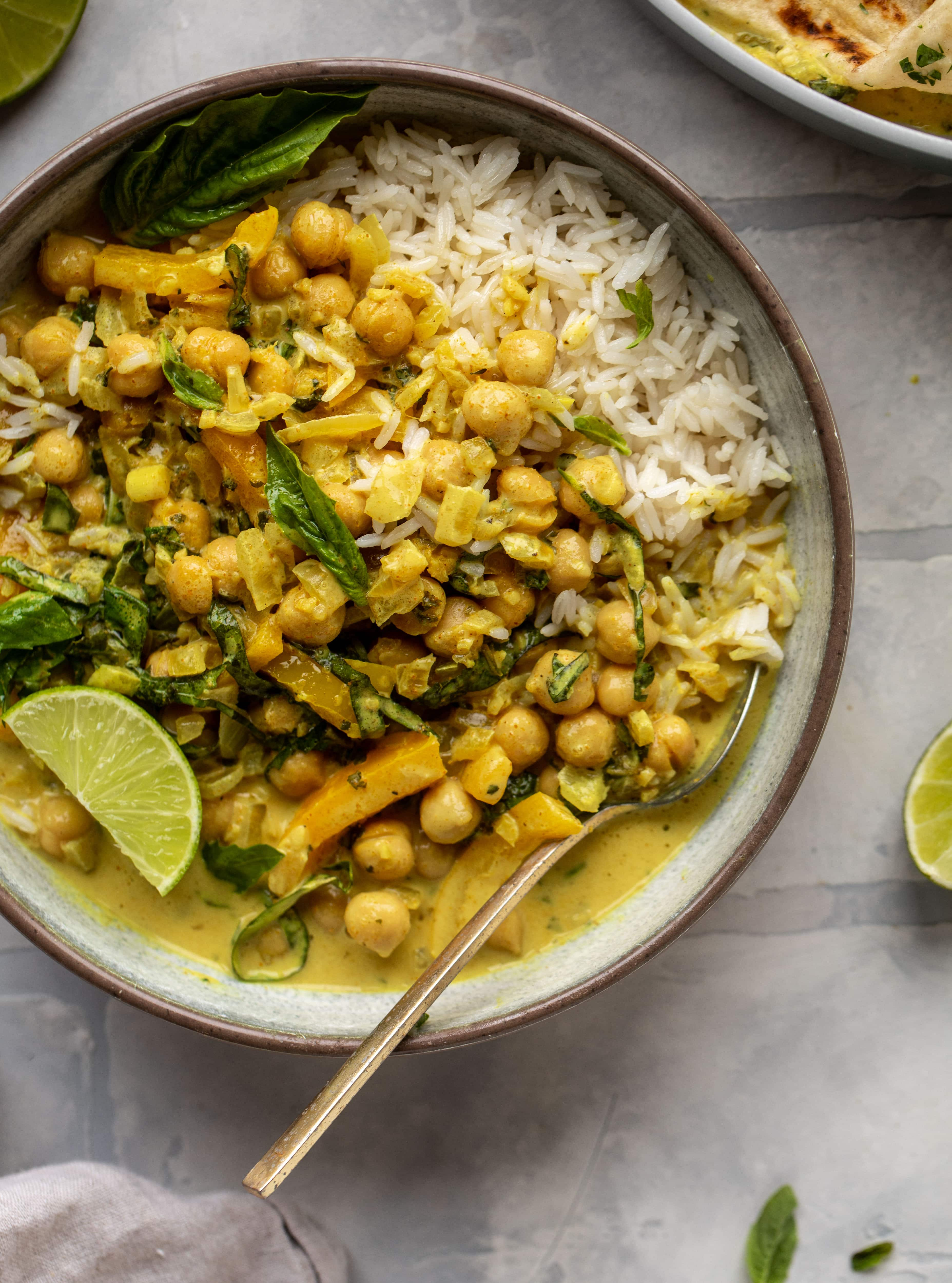 This basil chickpea coconut curry comes together in 20 minutes! Serve with jasmine rice or your favorite naan, or both! So easy and flavorful.