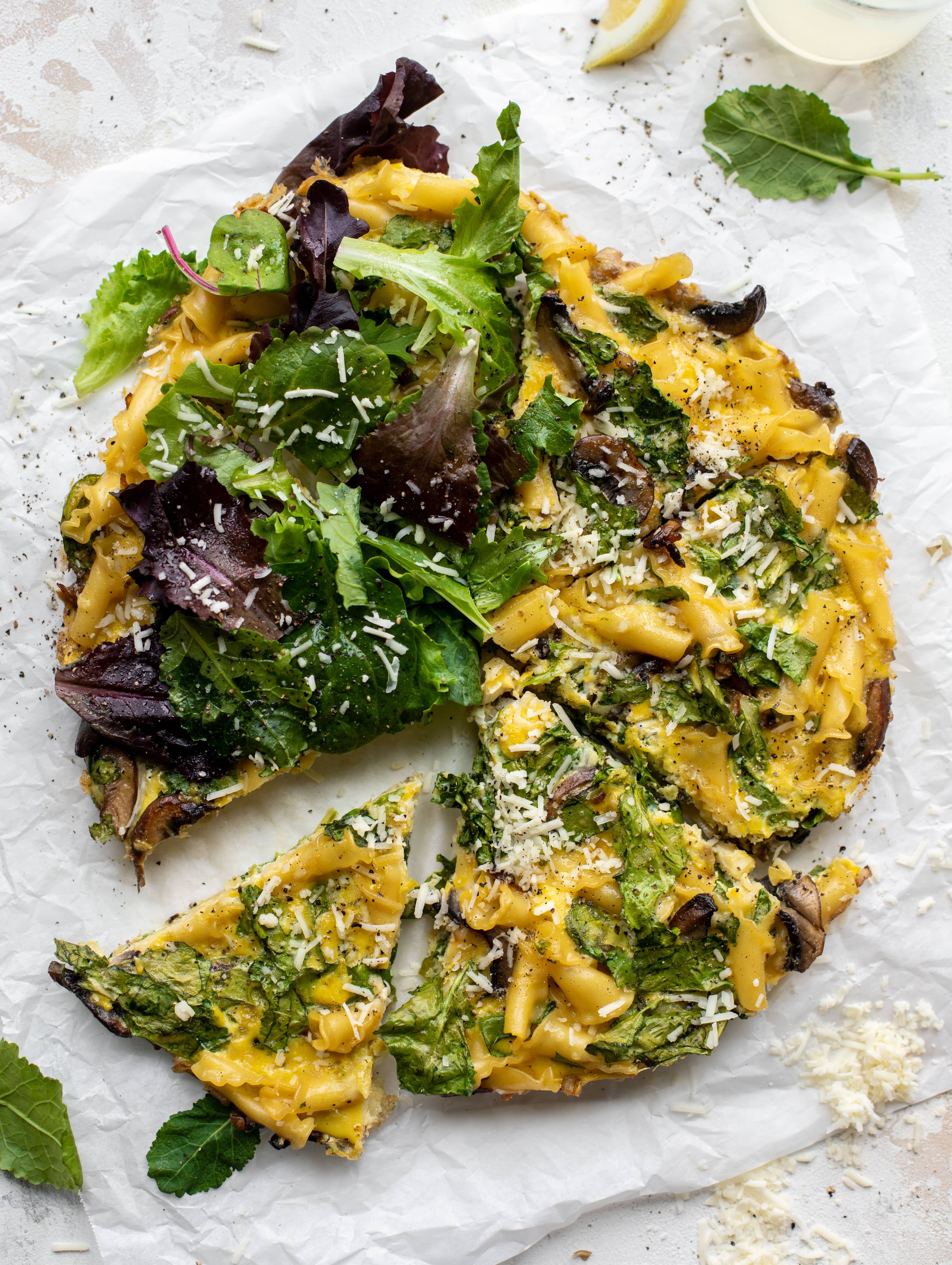 This super easy pasta frittata uses leftover ingredients and can be prepped ahead of time. Leftovers are great and it's satisfying and delicious!