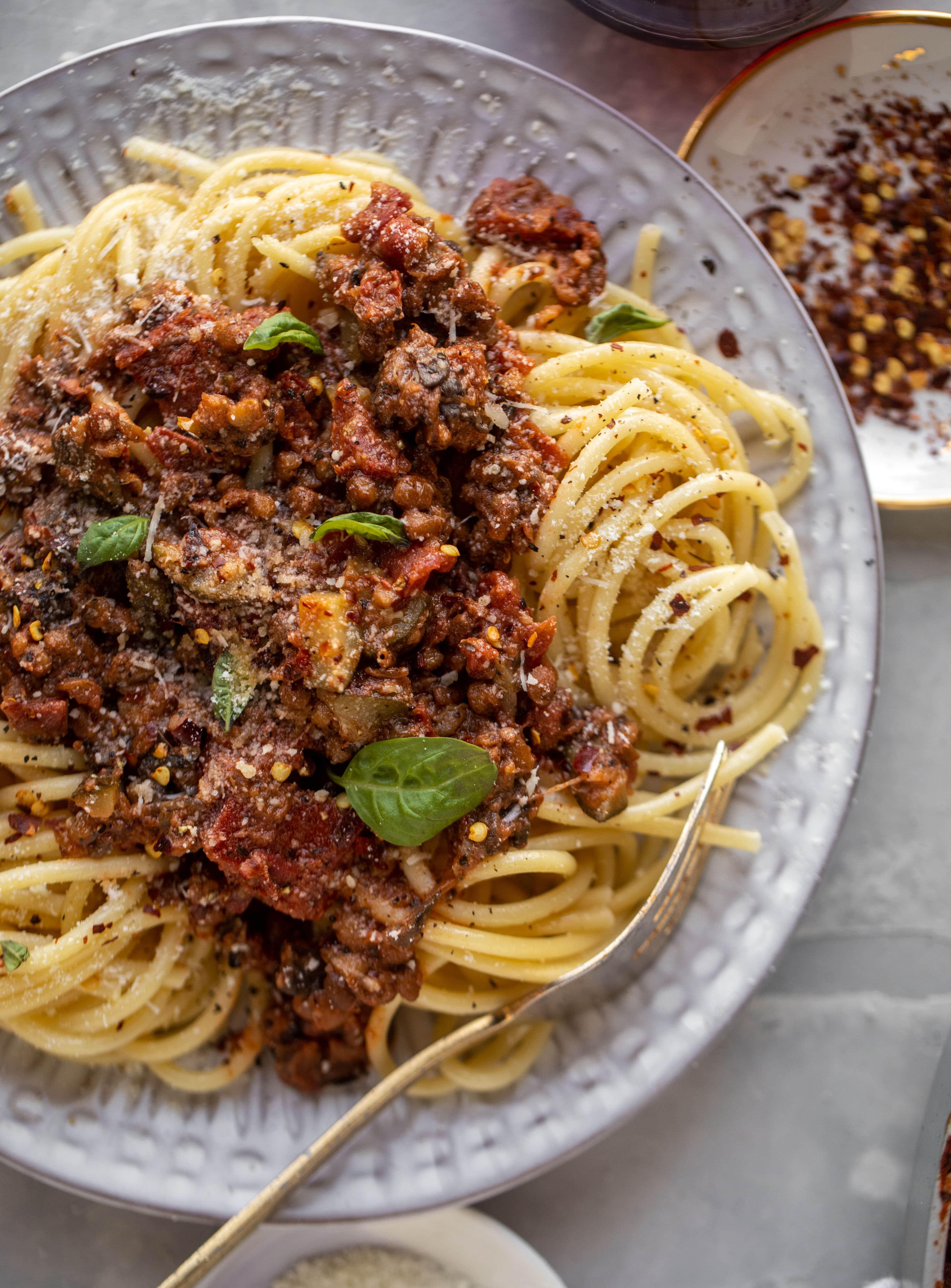up close lentil bolognese with a fork