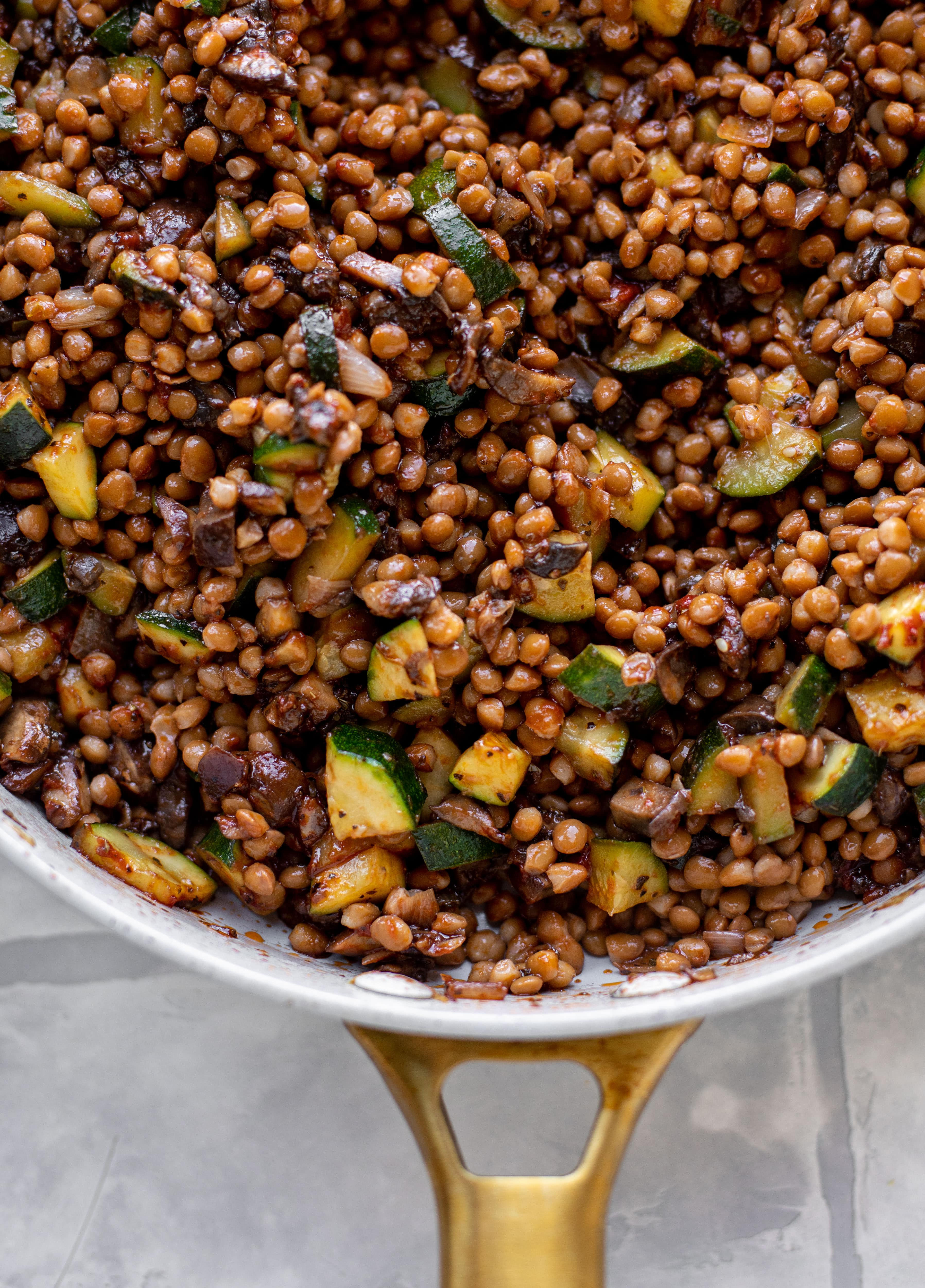 lentils with zucchini and mushrooms in a skillet