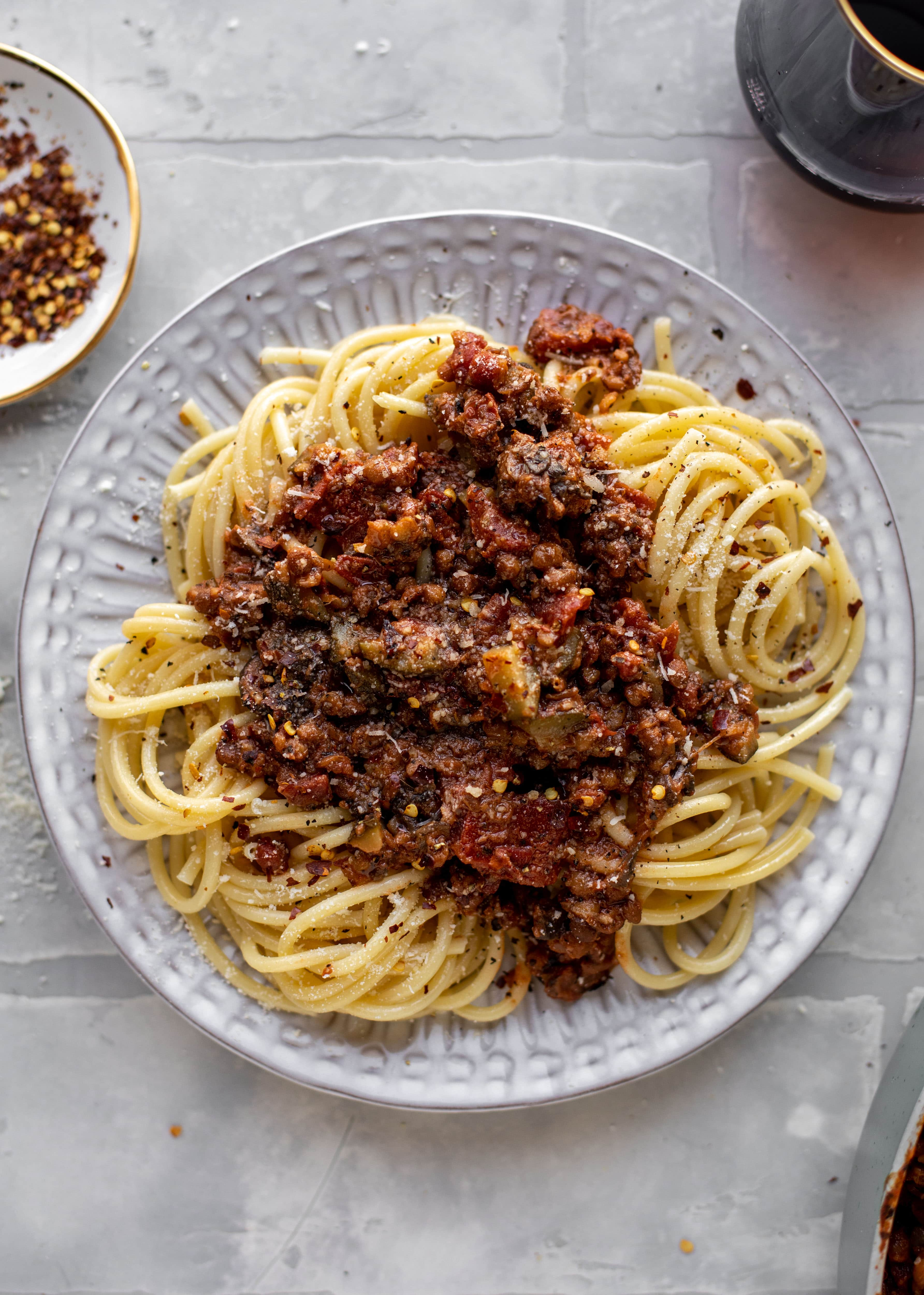 This lentil bolognese is incredible! Super hearty, loaded with vegetables, saucy, rich and decadent. You won't even miss the meat!