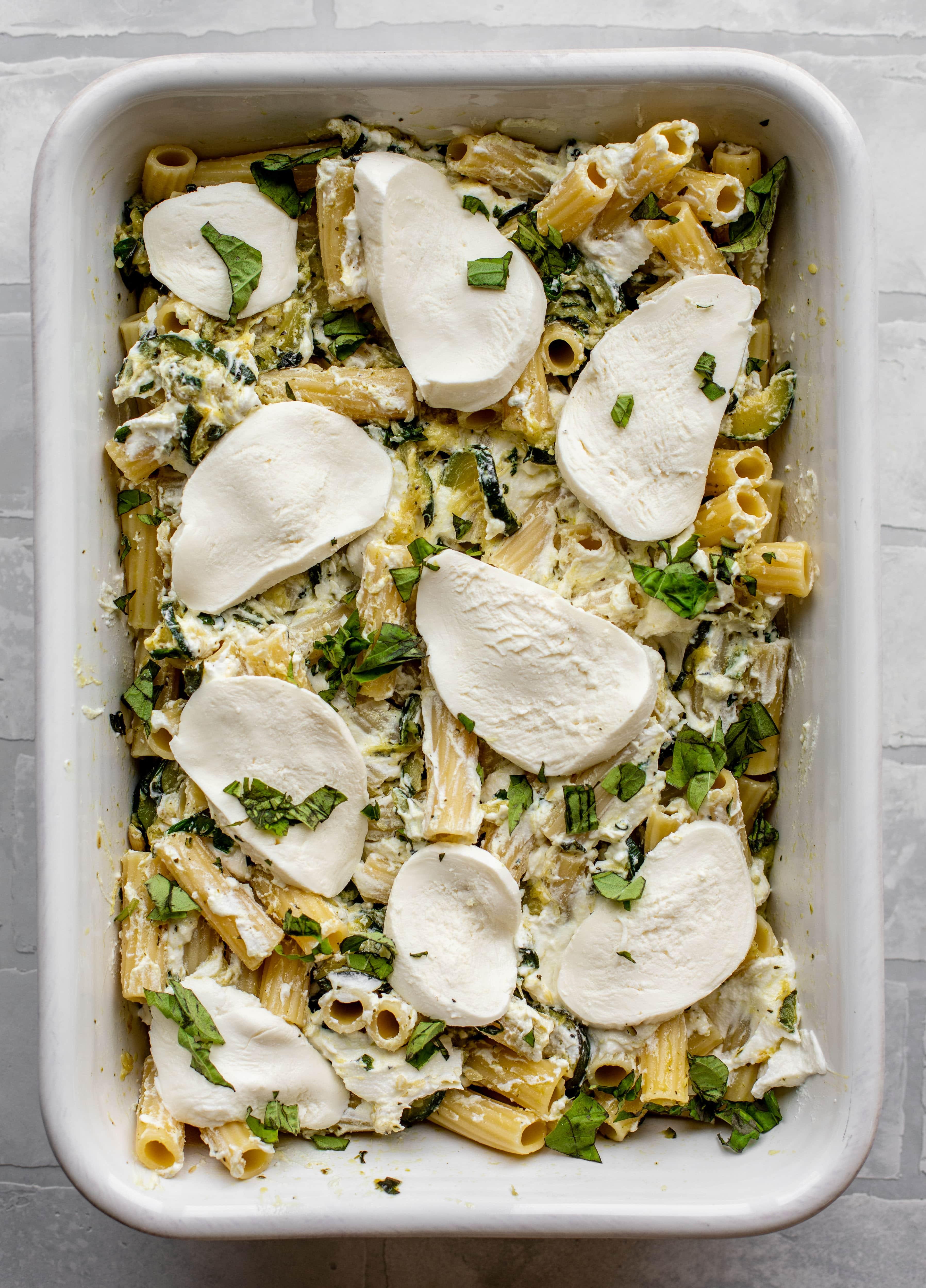 fresh mozzarella covering zucchini ziti