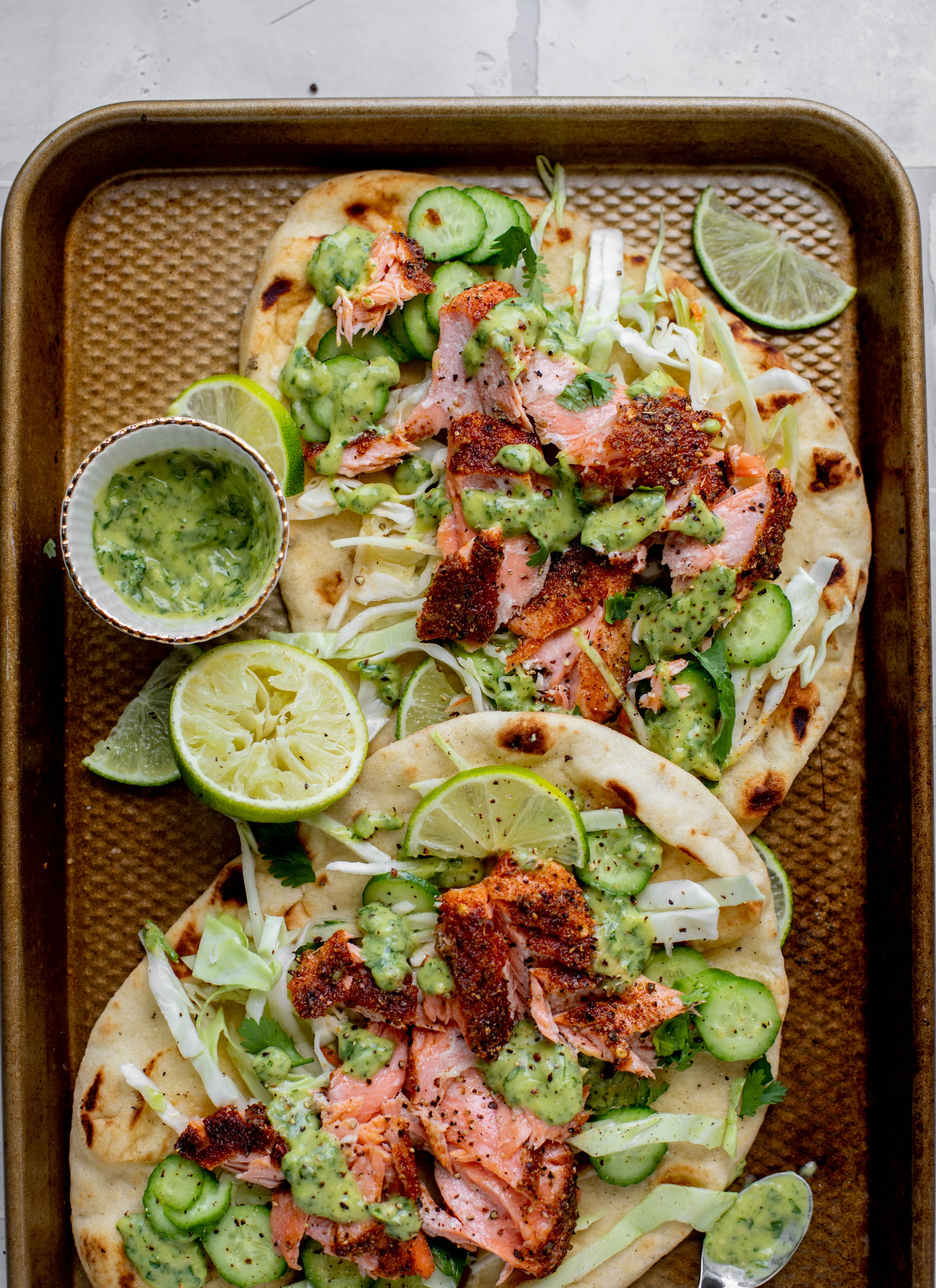 grilled salmon on naan bread with slaw and cilantro sauce