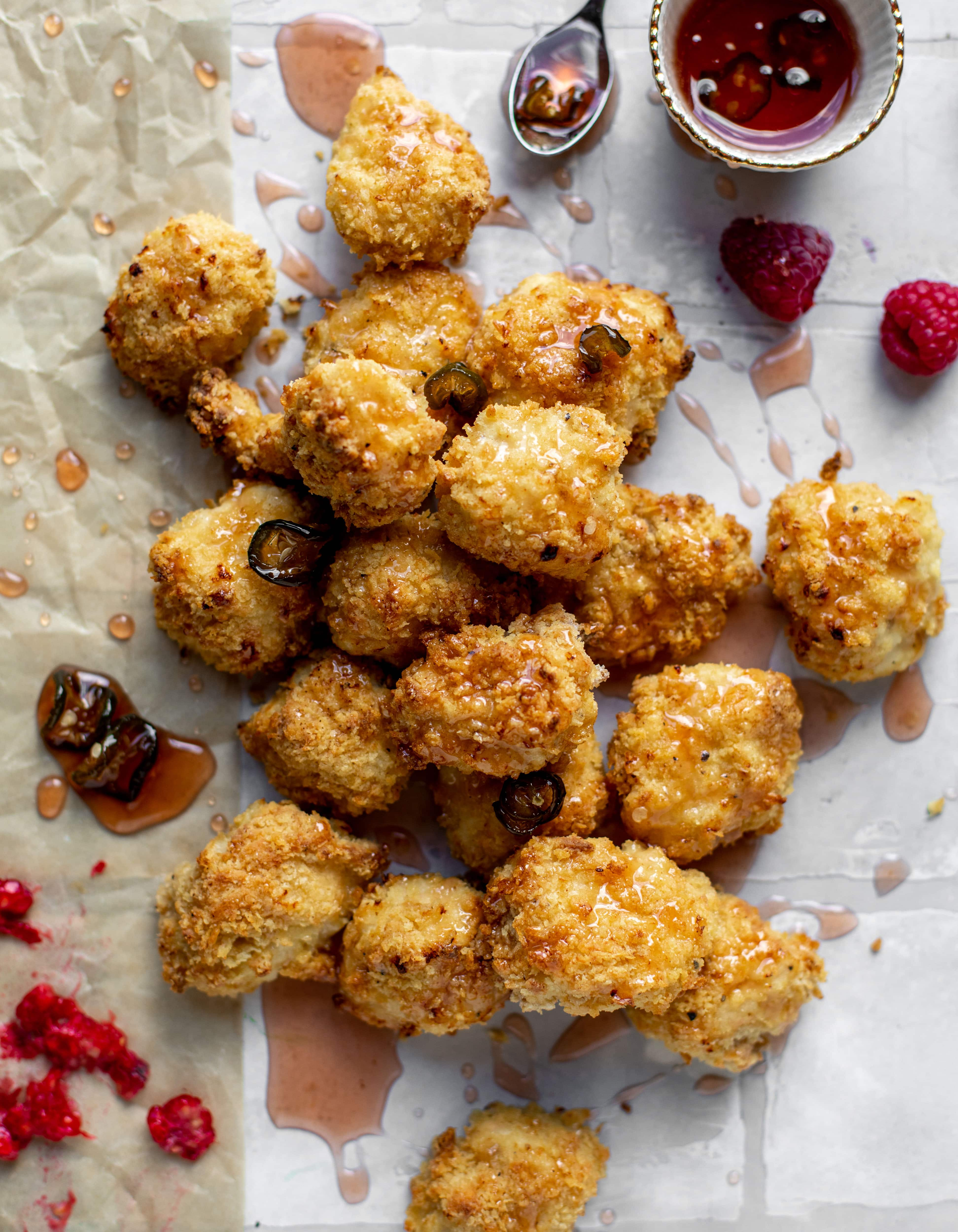 baked popcorn chicken with raspberry hot honey