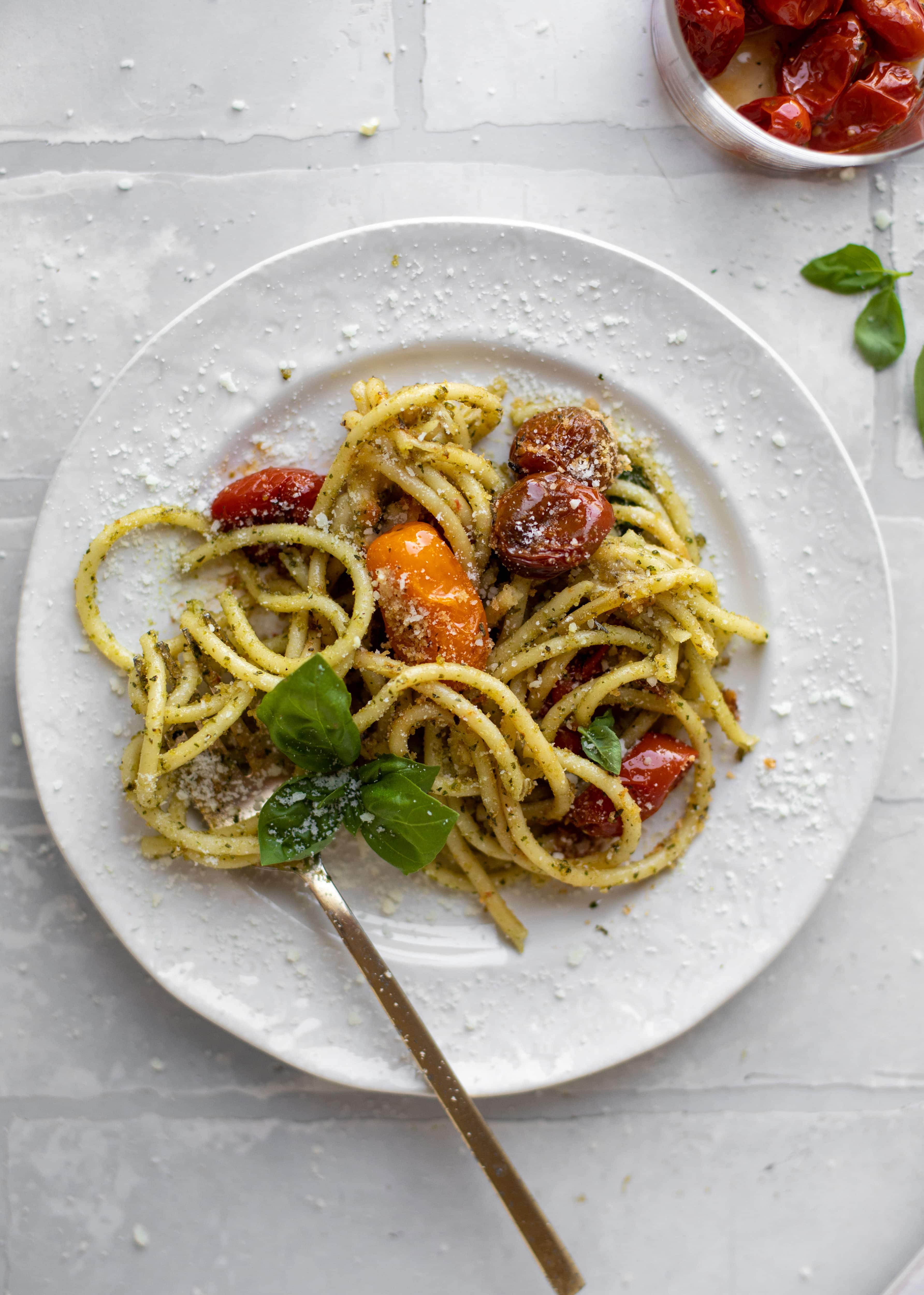fork twirling baked pesto pasta
