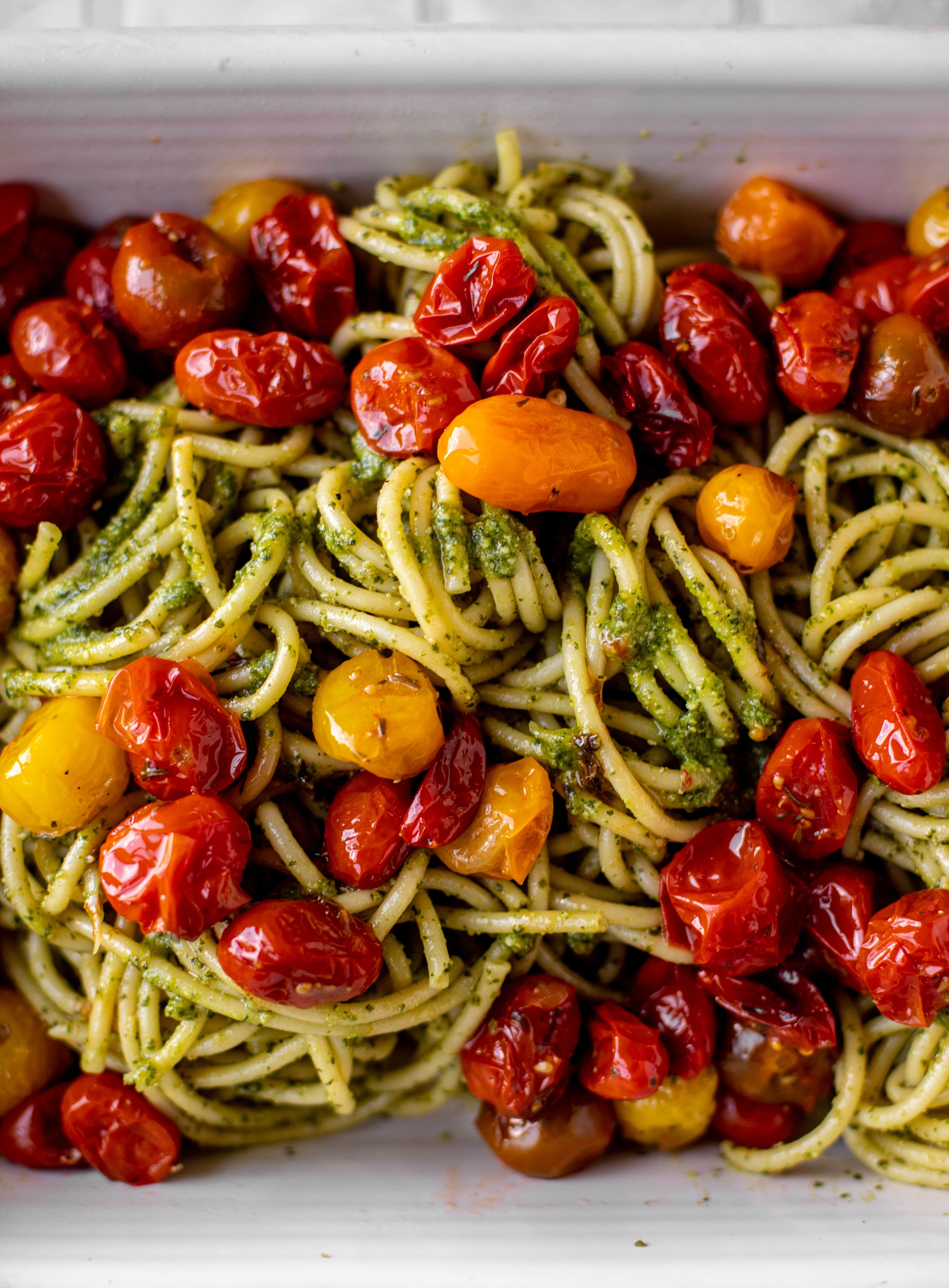 baked pesto bucatini with burst tomatoes