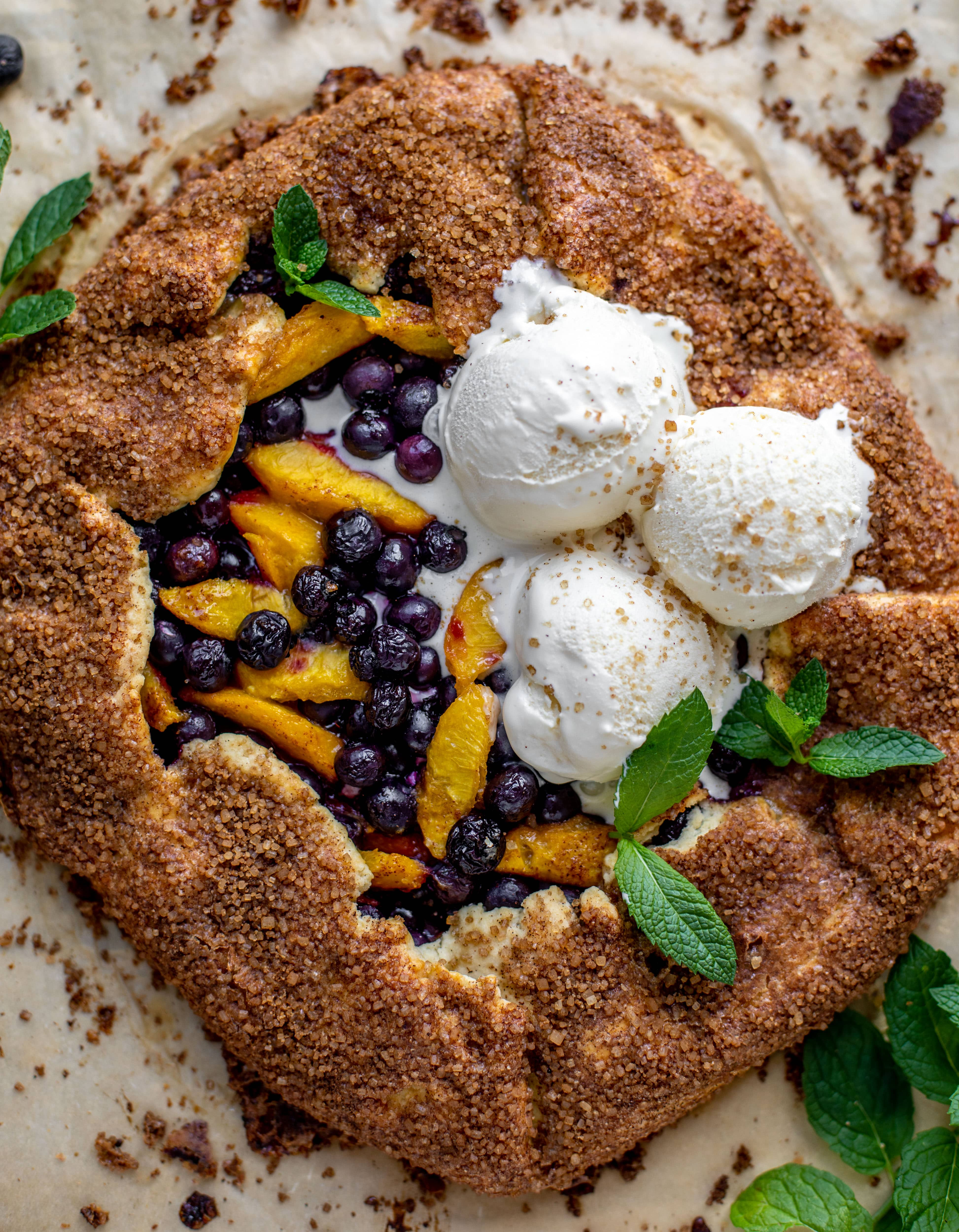 blueberry peach galette with cinnamon sugar galette topped with ice cream