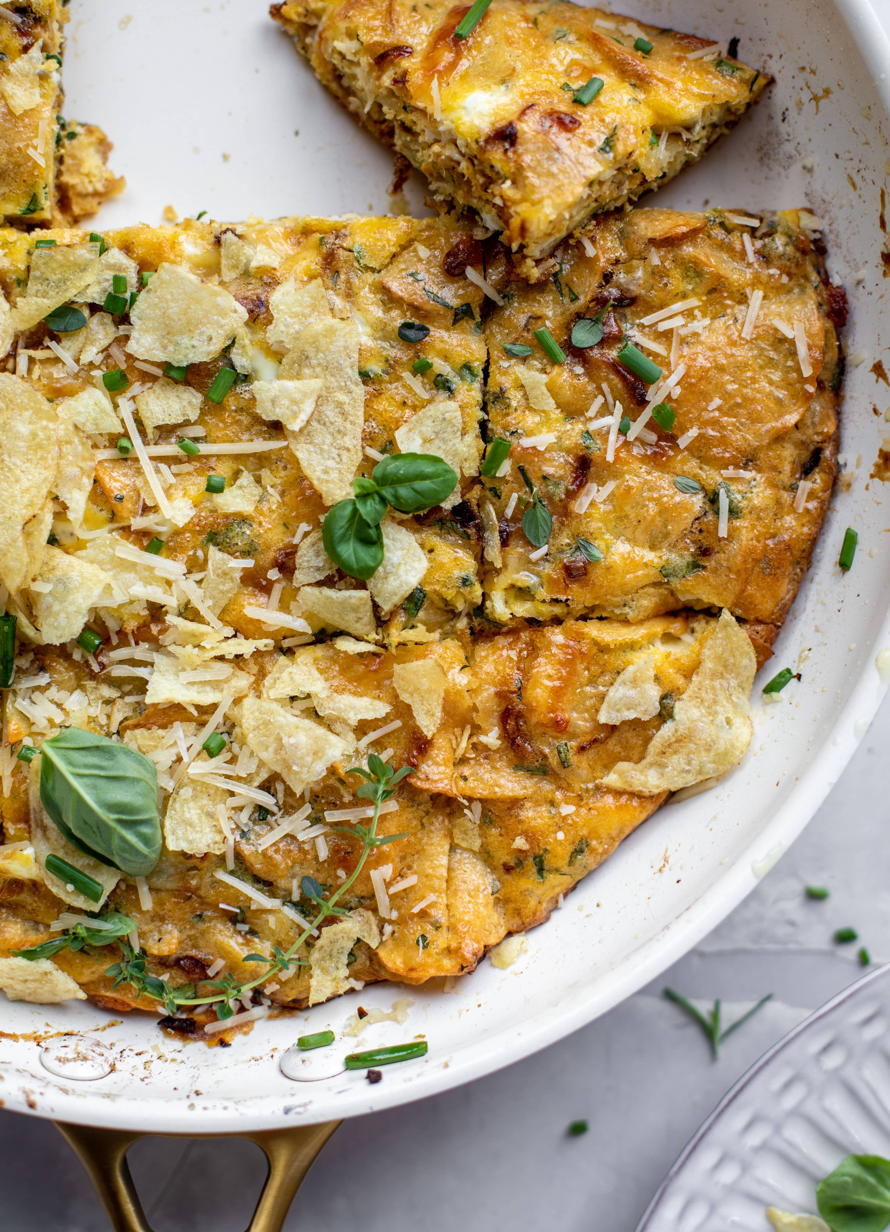 sliced potato chip frittata with fresh herbs