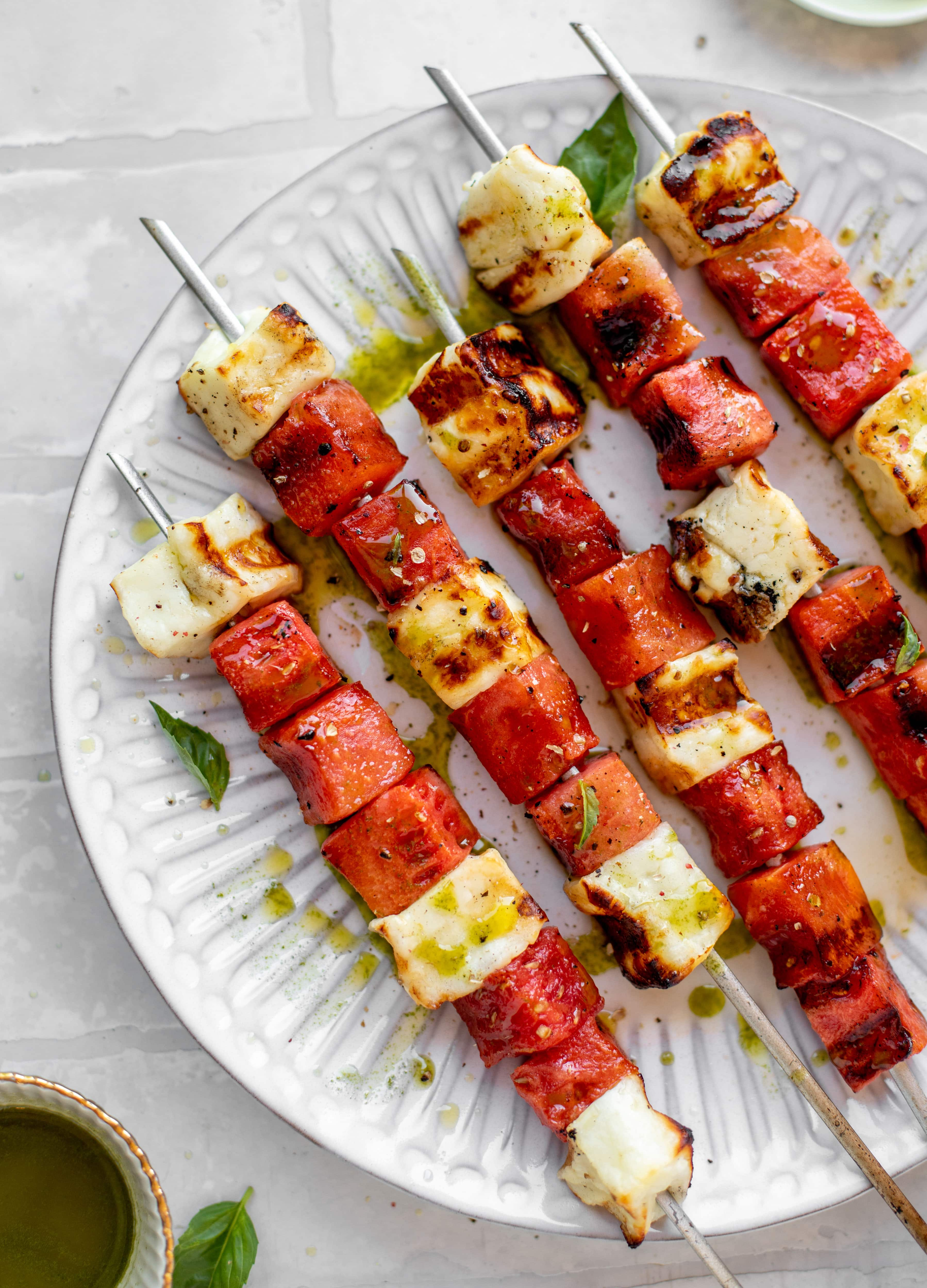 grilled watermelon halloumi skewers with mint basil oil