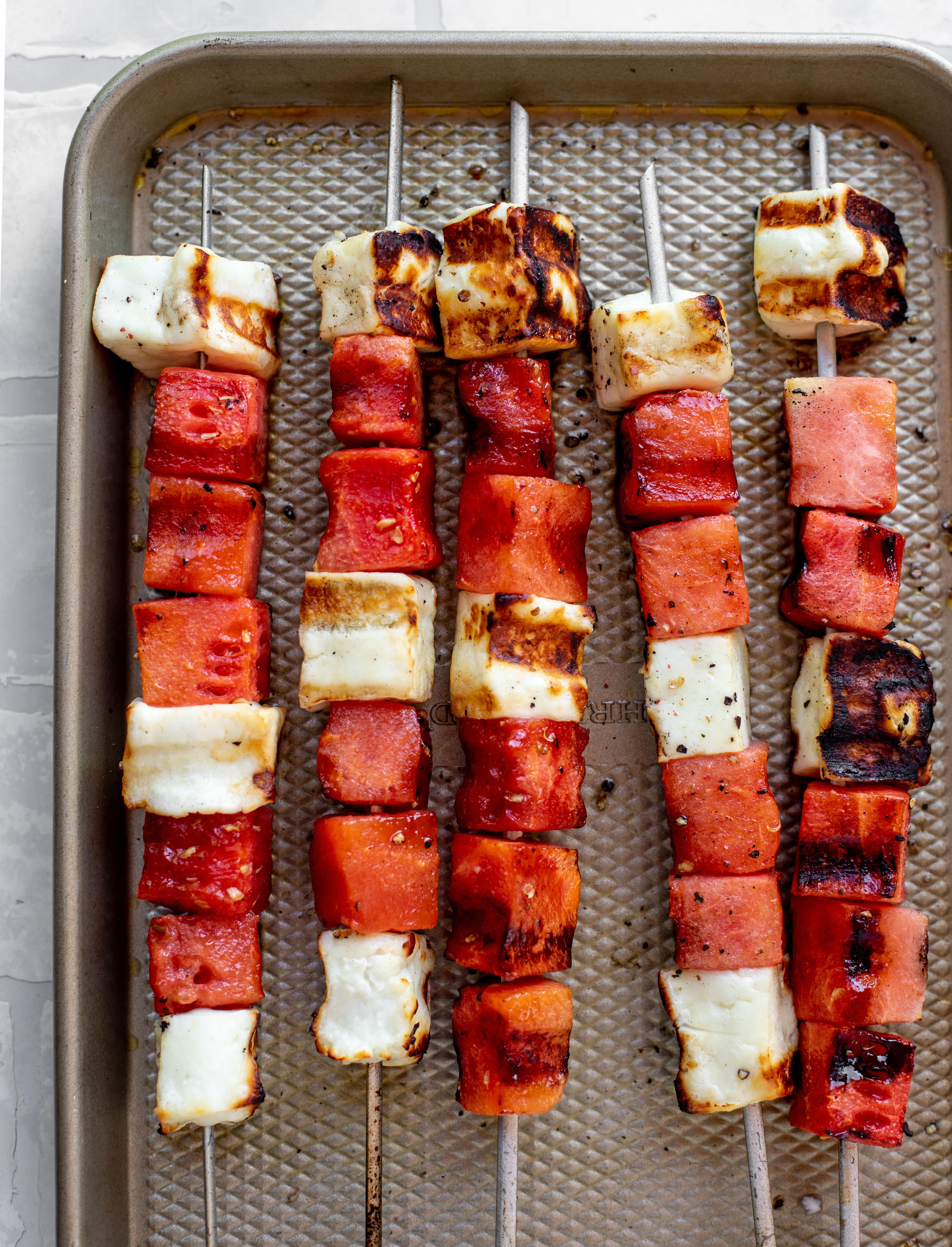 grilled watermelon halloumi skewers right off the grill