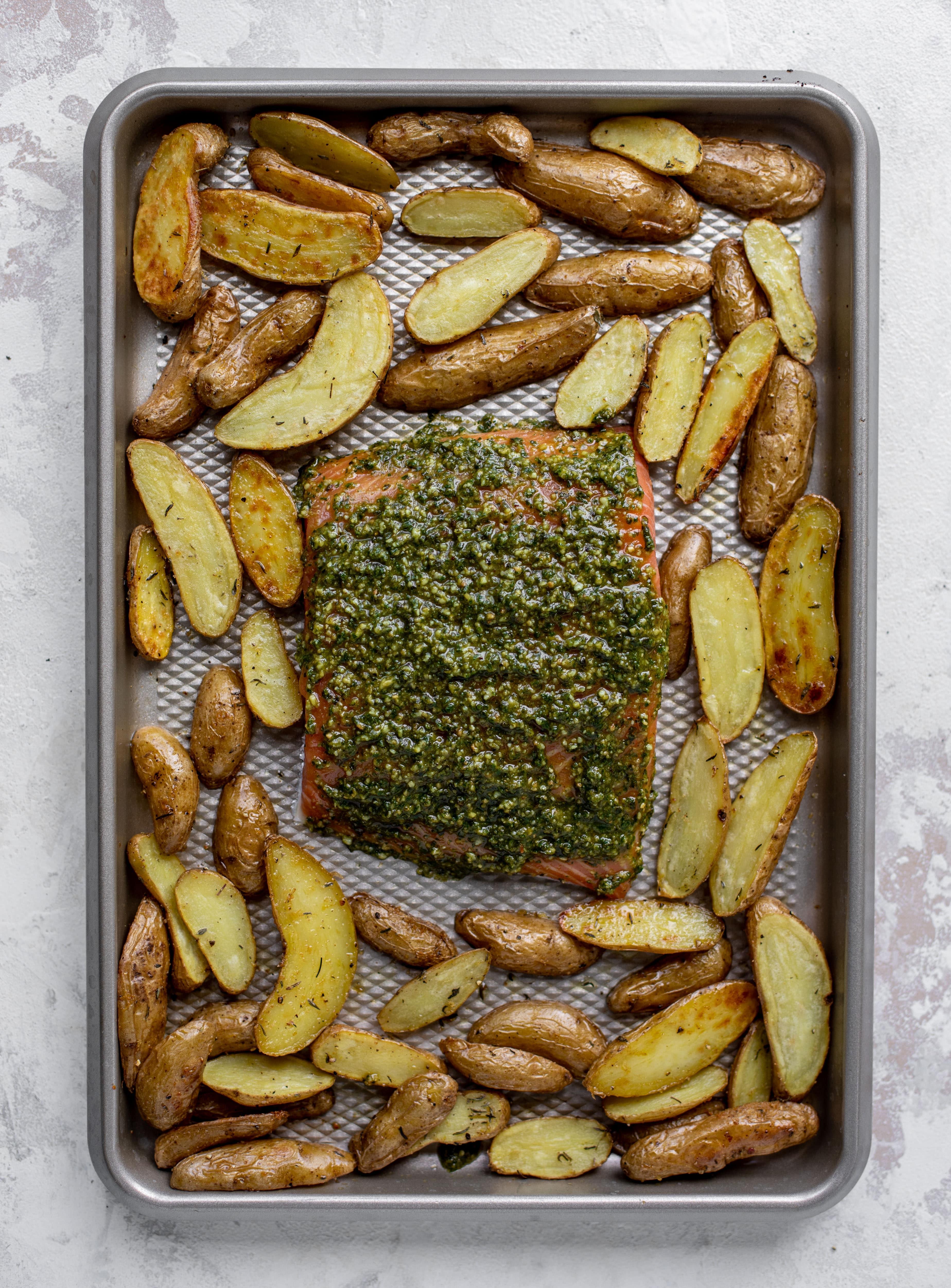 sheet pan pesto salmon ready for the oven