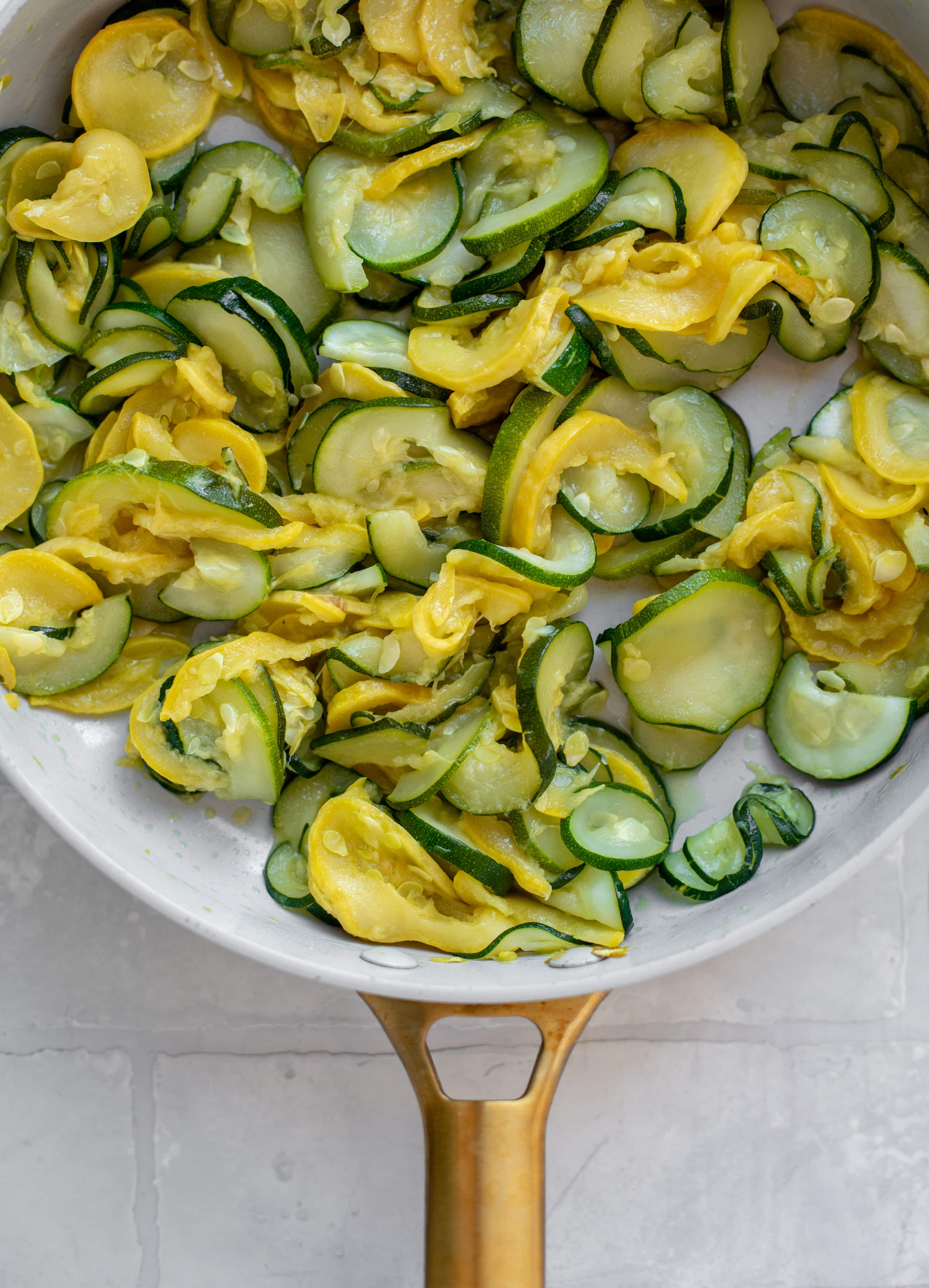 summer squash and zucchini in a skillet