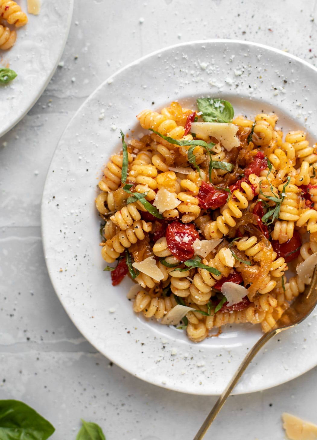 caramelized onion tomato pasta with basil