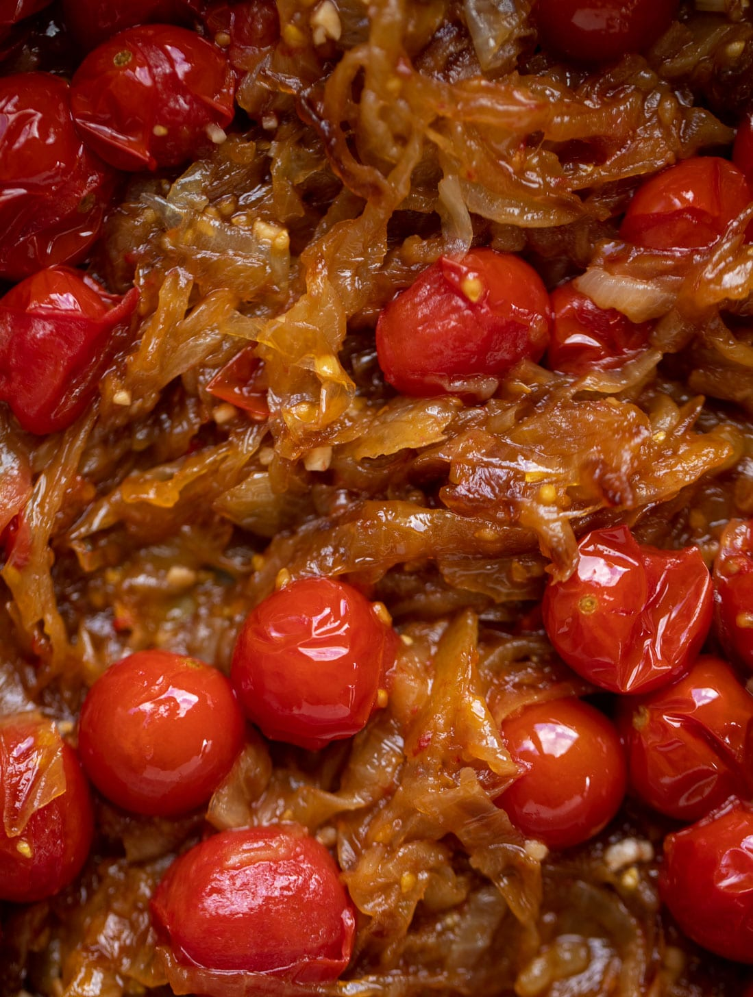 caramelized onions and burst cherry tomatoes