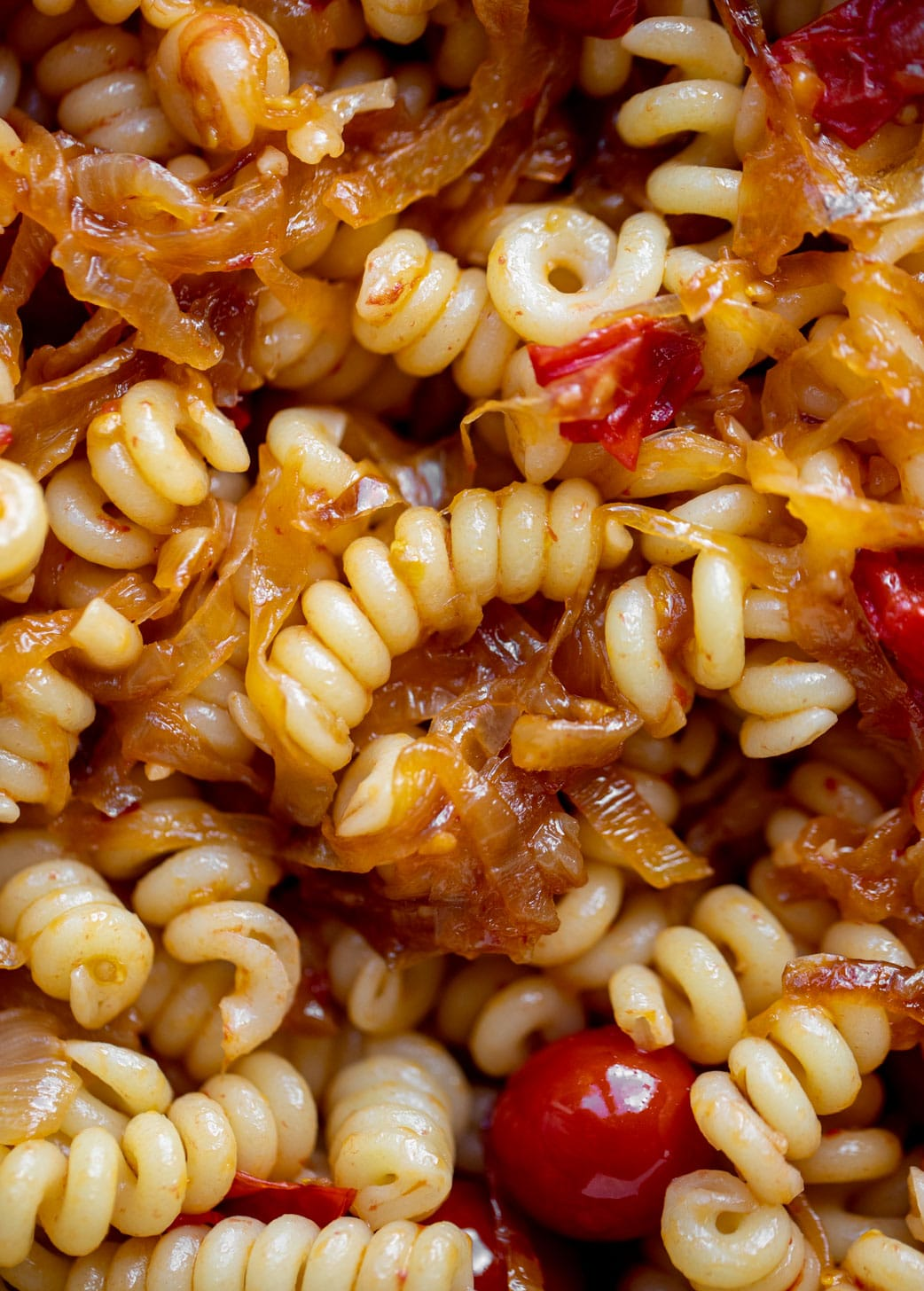 caramelized onion burst tomato pasta up close