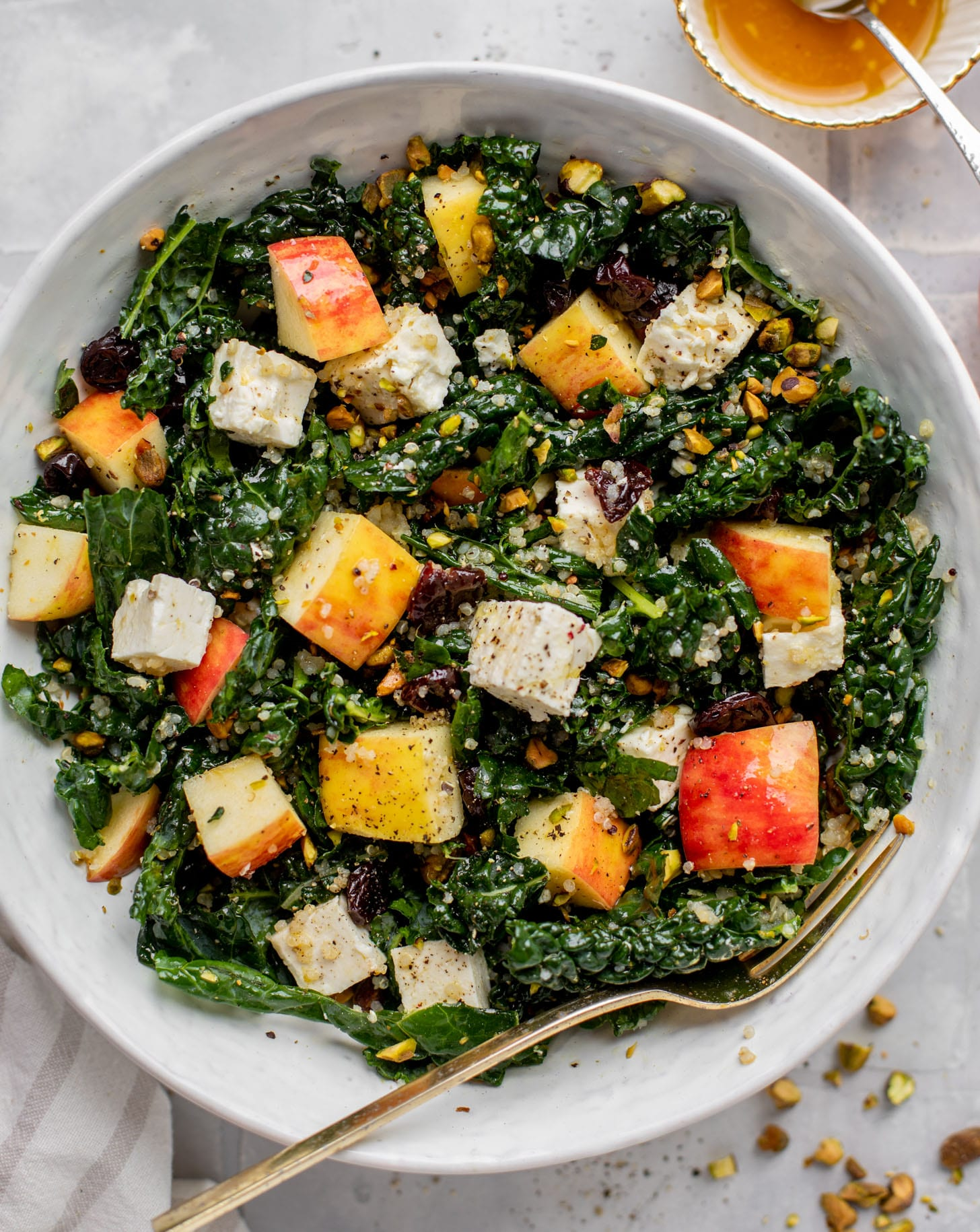 honeycrisp quinoa salad with kale and pistachios