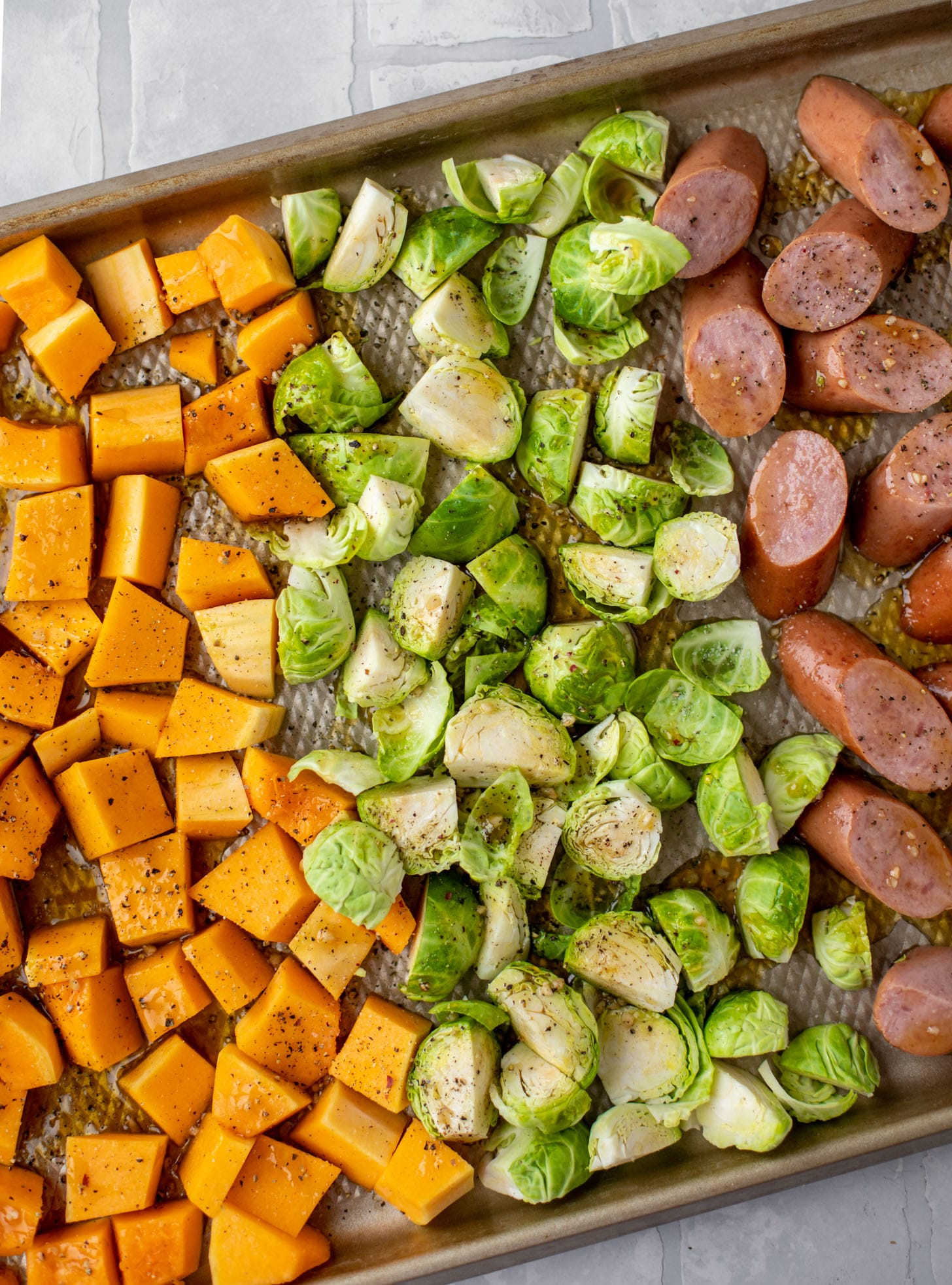 squash, brussels and sausage on the sheet pan