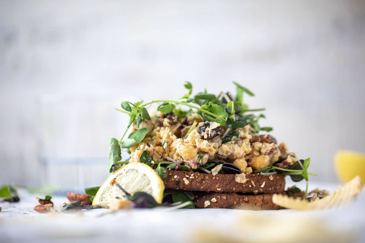 smashed chickpea salad on toast with micro greens