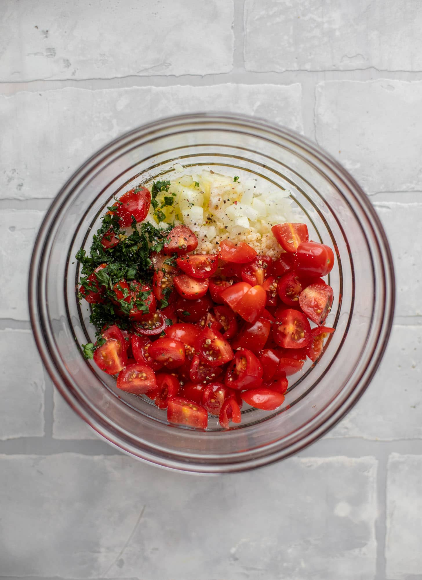 tomatoes, basil, onion, garlic in a bowl