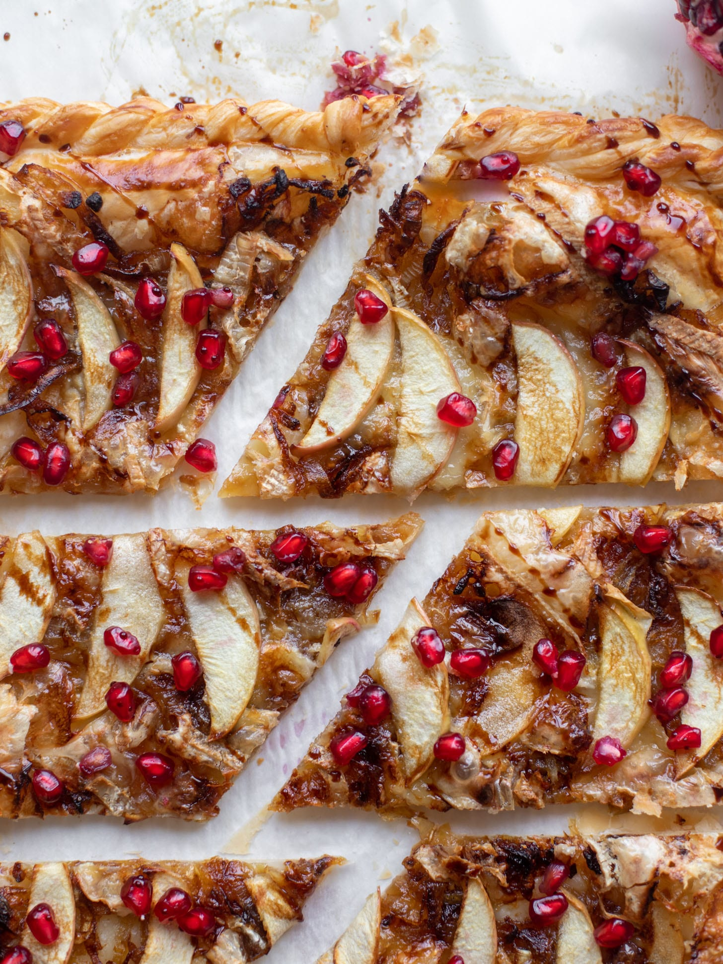 caramelized onion, apple and brie puff pastry tart with pomegranate molasses