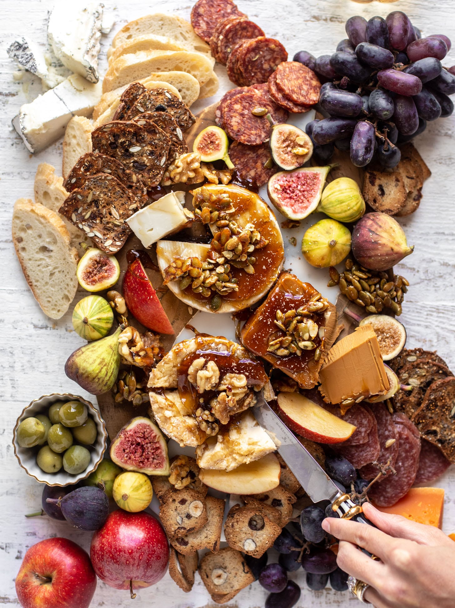 autumn cheese board with bourbon crackling caramel and honey roasted pepitas