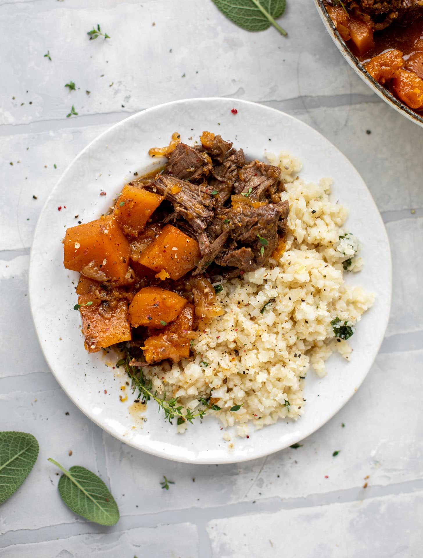 cider braised pot roast with caramelized onions, butternut squash and cauliflower rice