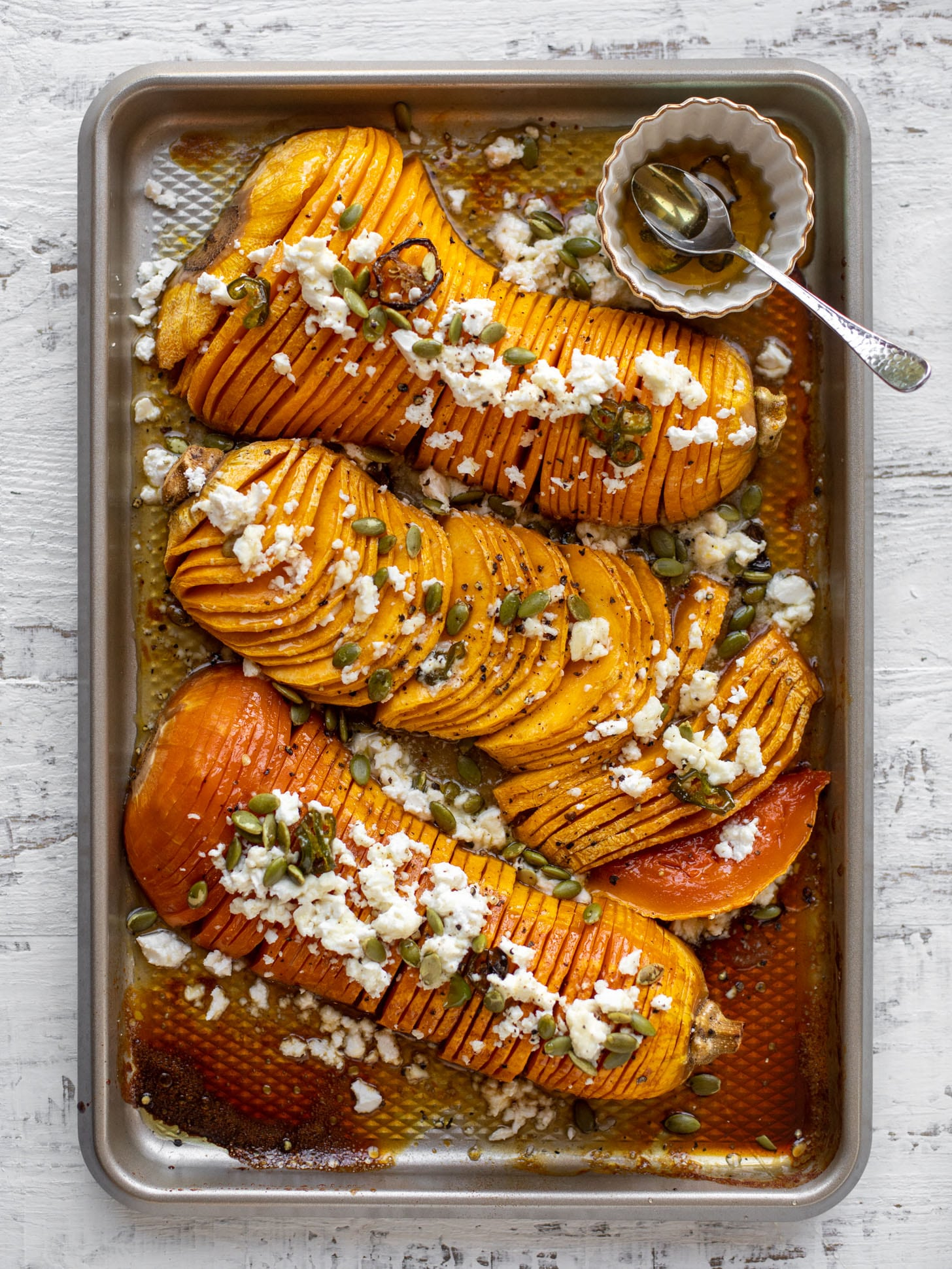 Hot Honey Hasselback Squash With Feta And Pepitas