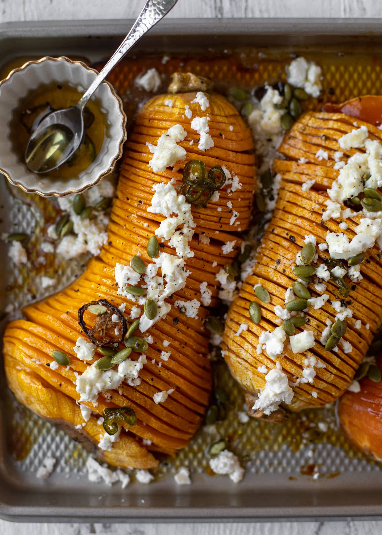 hot honey hasselback butternut squash with feta and pepitas