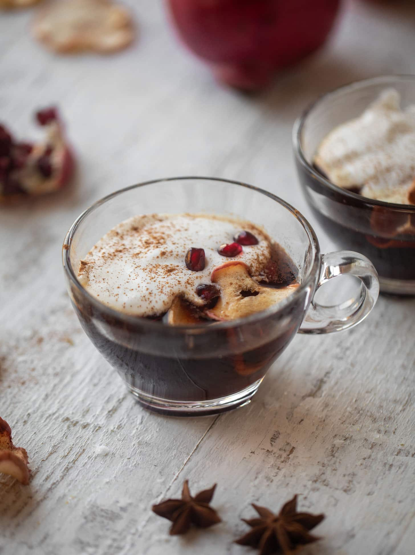 hot pomegranate cider with whipped cream