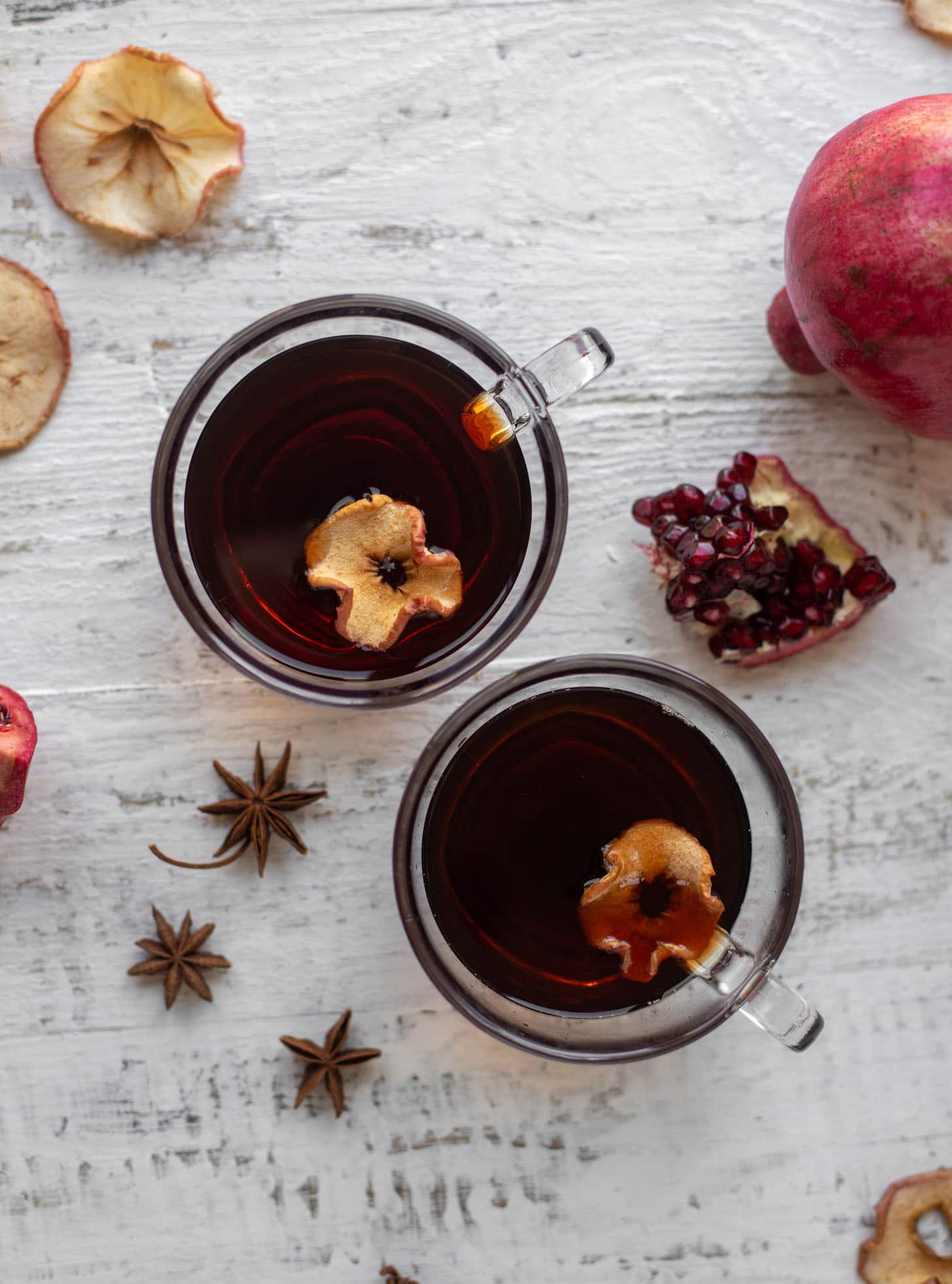 hot pomegranate cider with dried apple slices