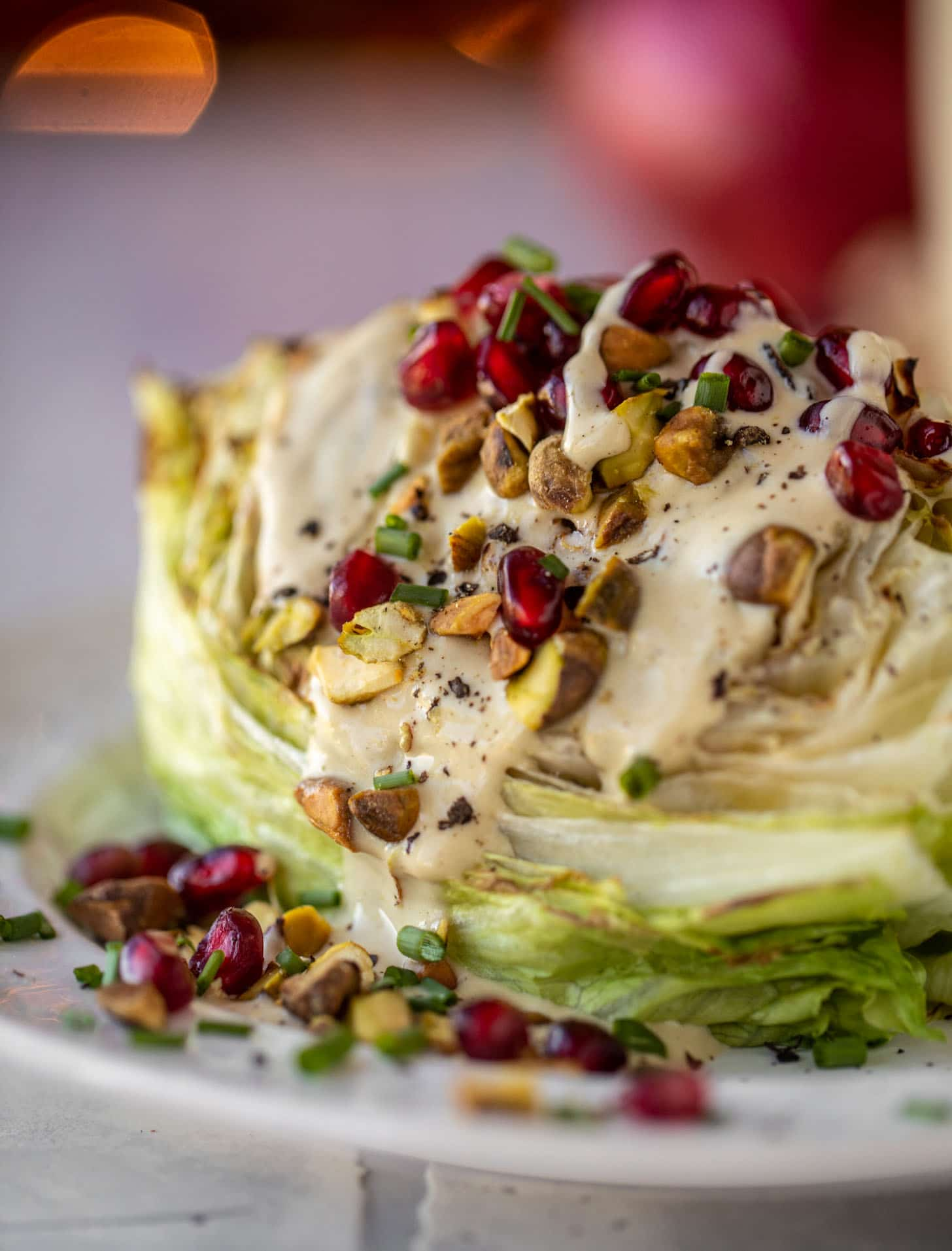 broiled wedge salad with pomegranates and pistachios