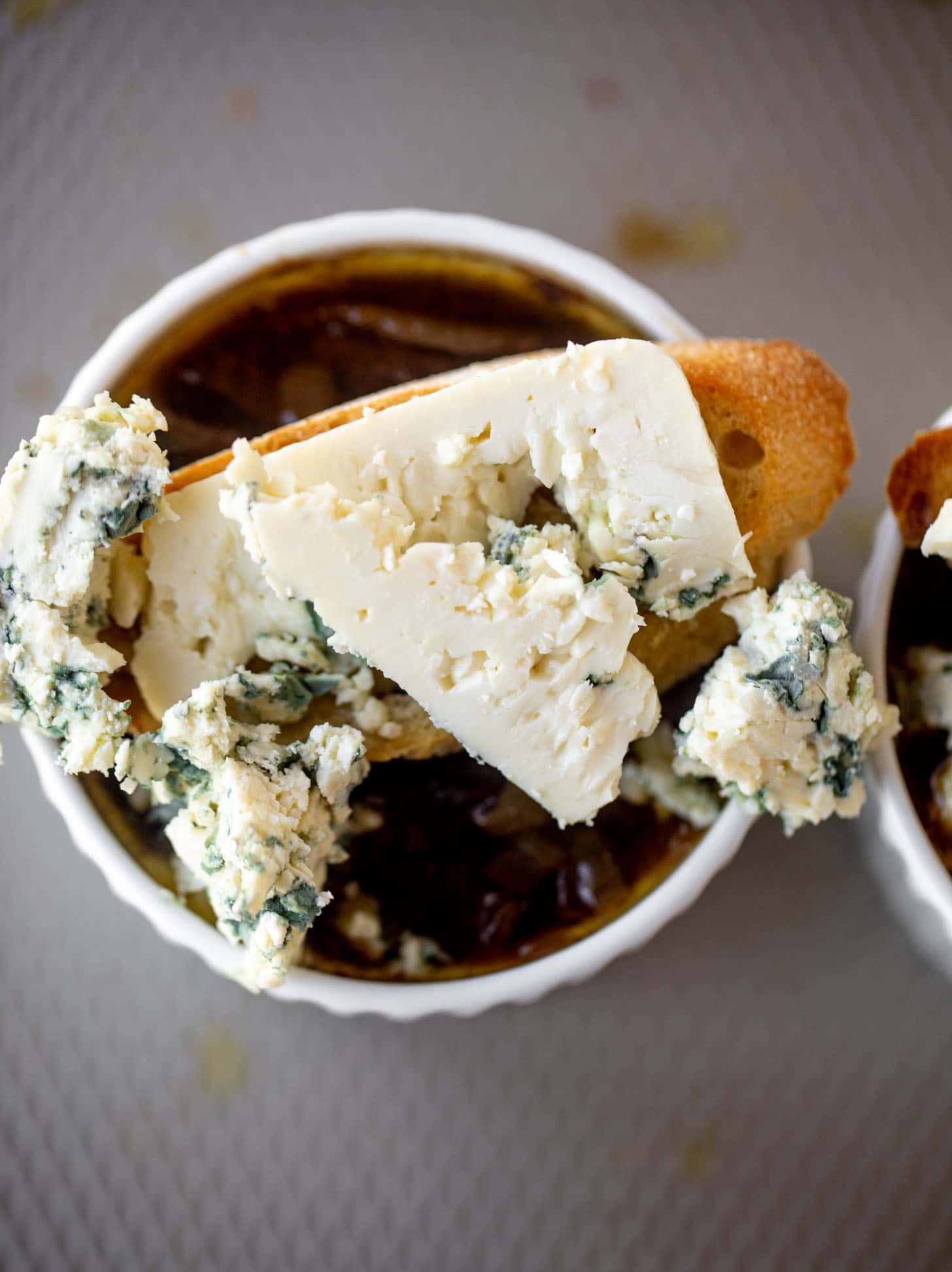 french onion soup topped with baguettes and blue cheese