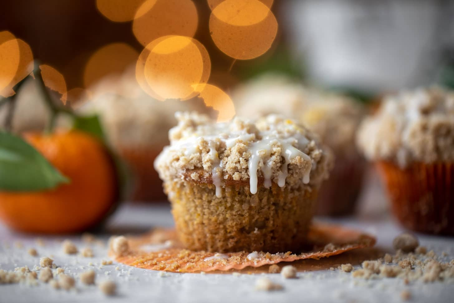 orange cinnamon coffee cake muffins with orange glaze