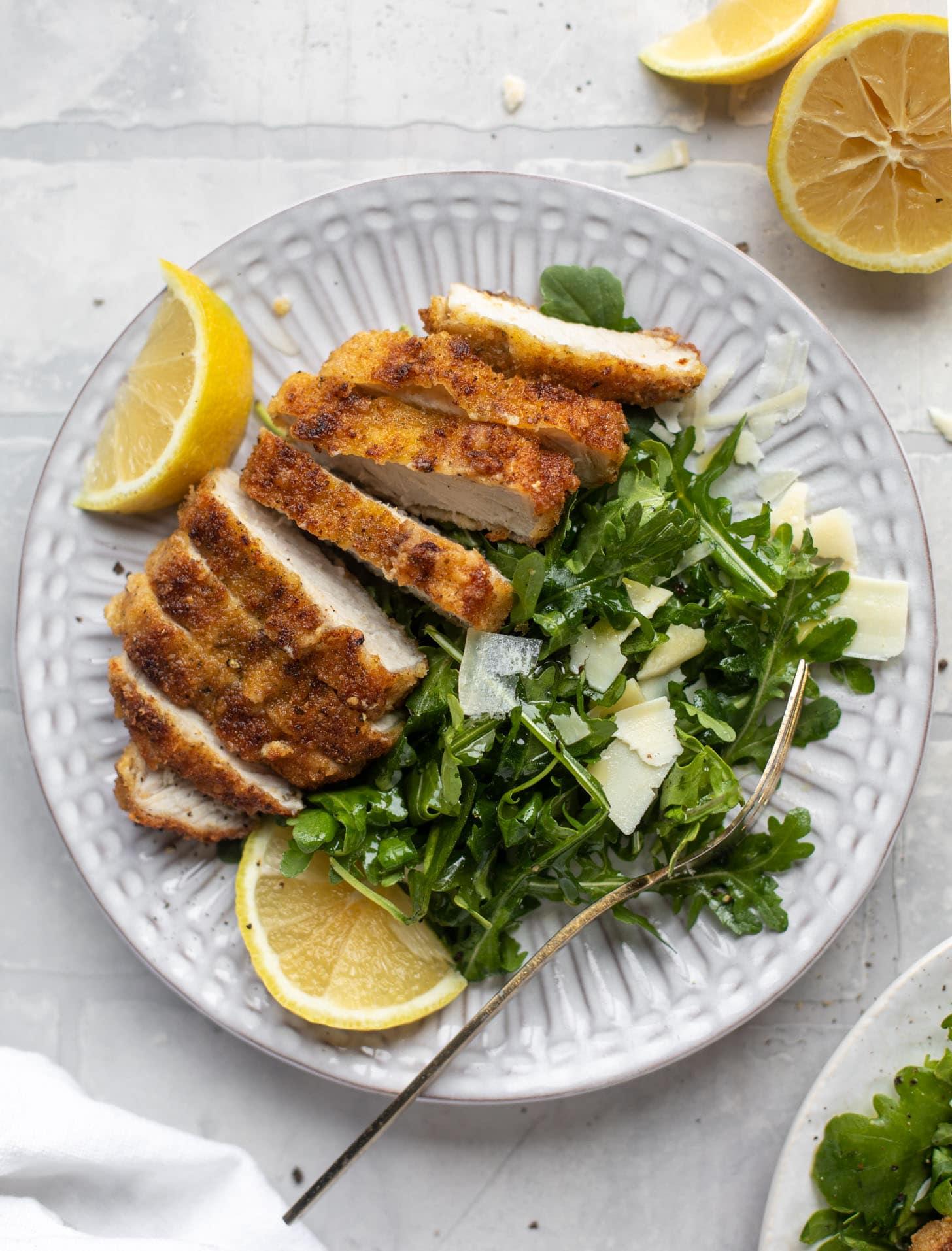 pork milanese with lemon arugula greens
