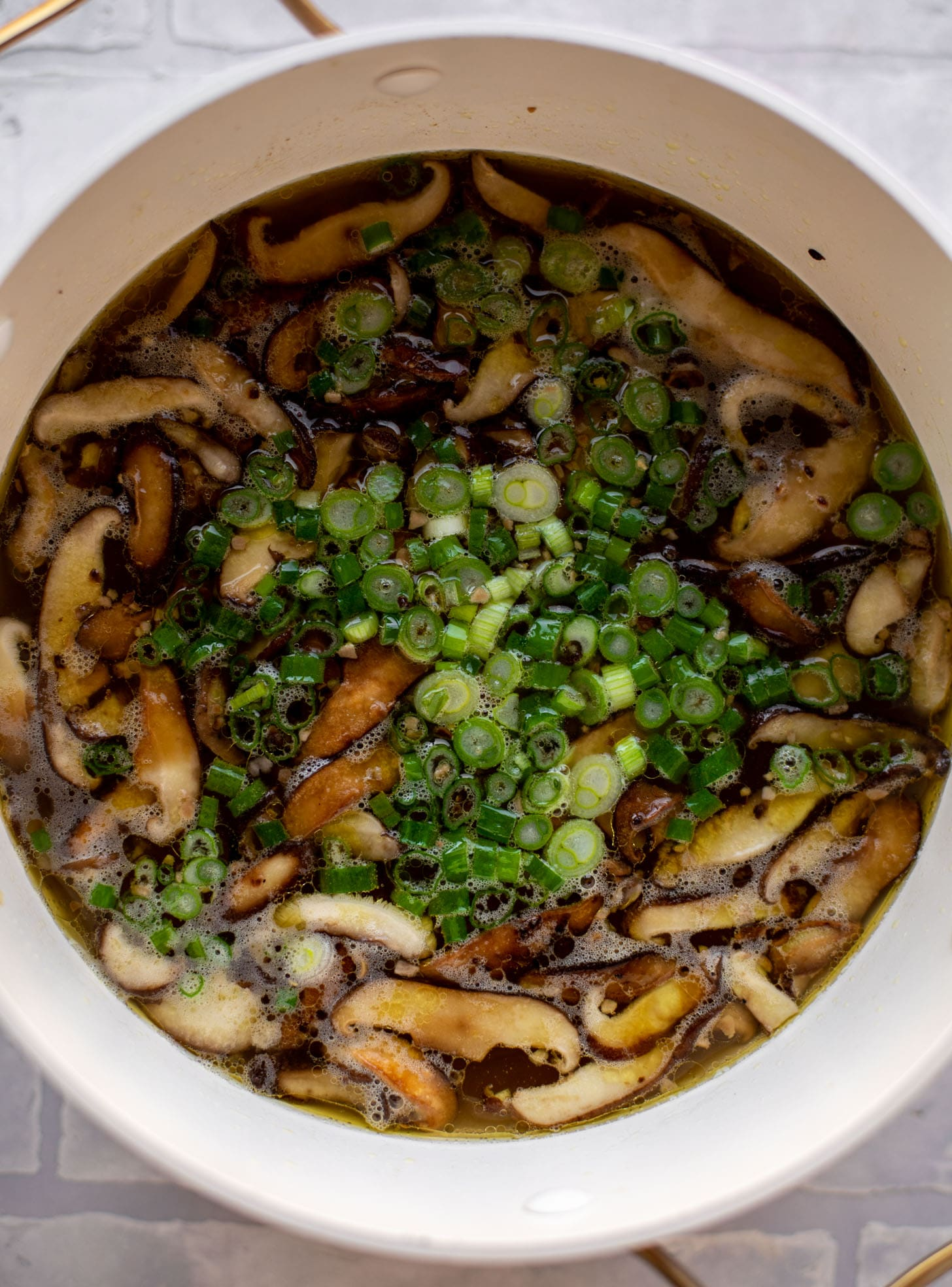 broth with shiitake mushrooms and scallions