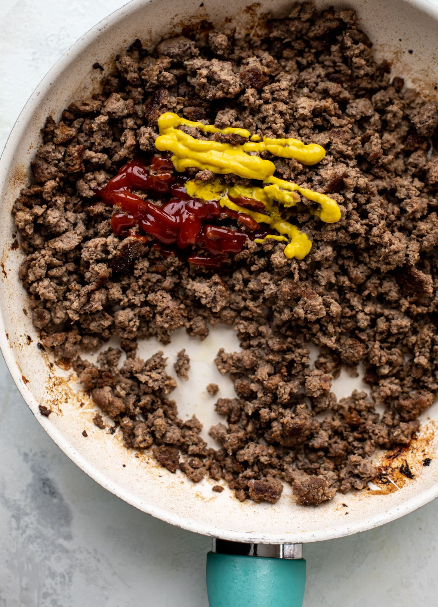 ground beef with ketchup and mustard