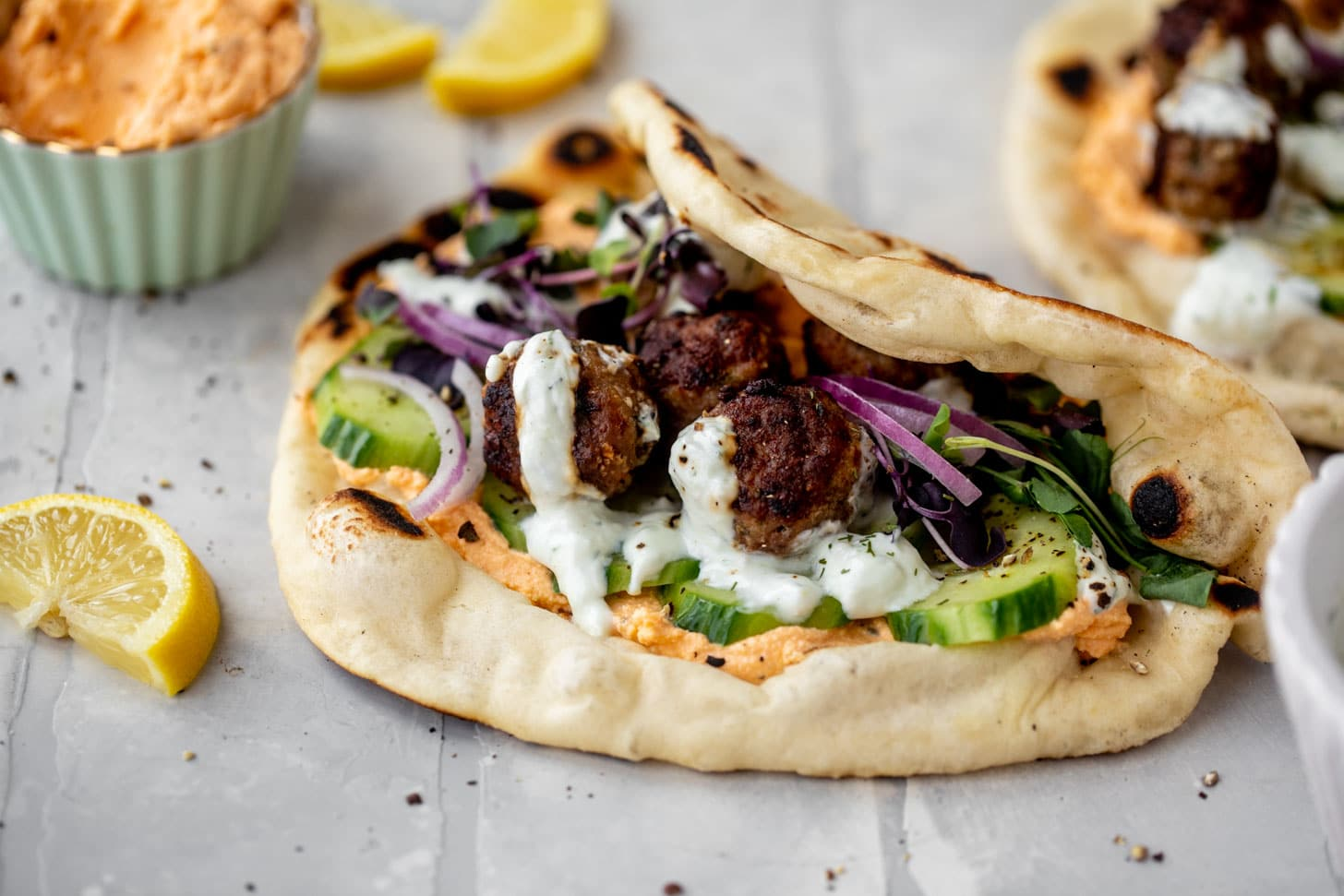 chicken meatball pitas with roasted red pepper whipped feta