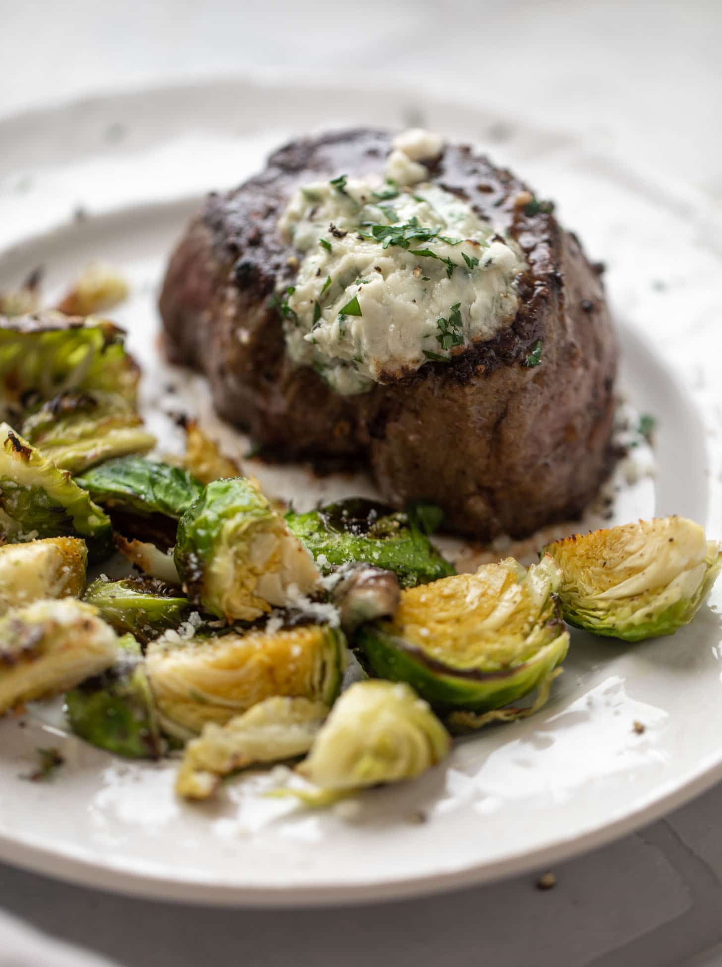filet mignon with blue cheese butter and cacio e pepe brussels