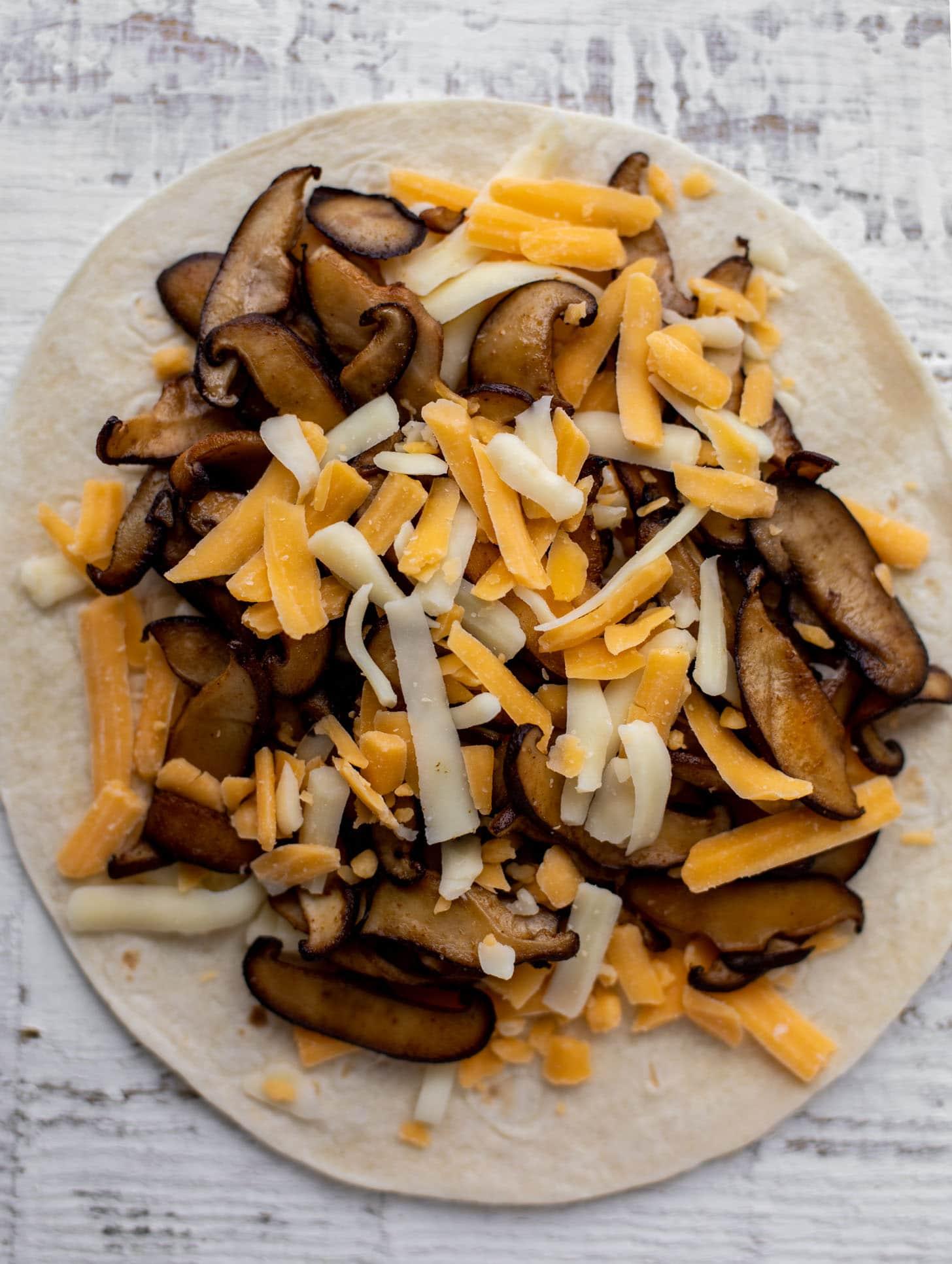 mushroom and cheese on tortilla