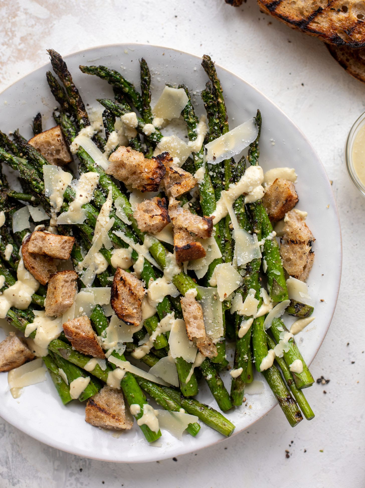 grilled asparagus caesar with sourdough croutons