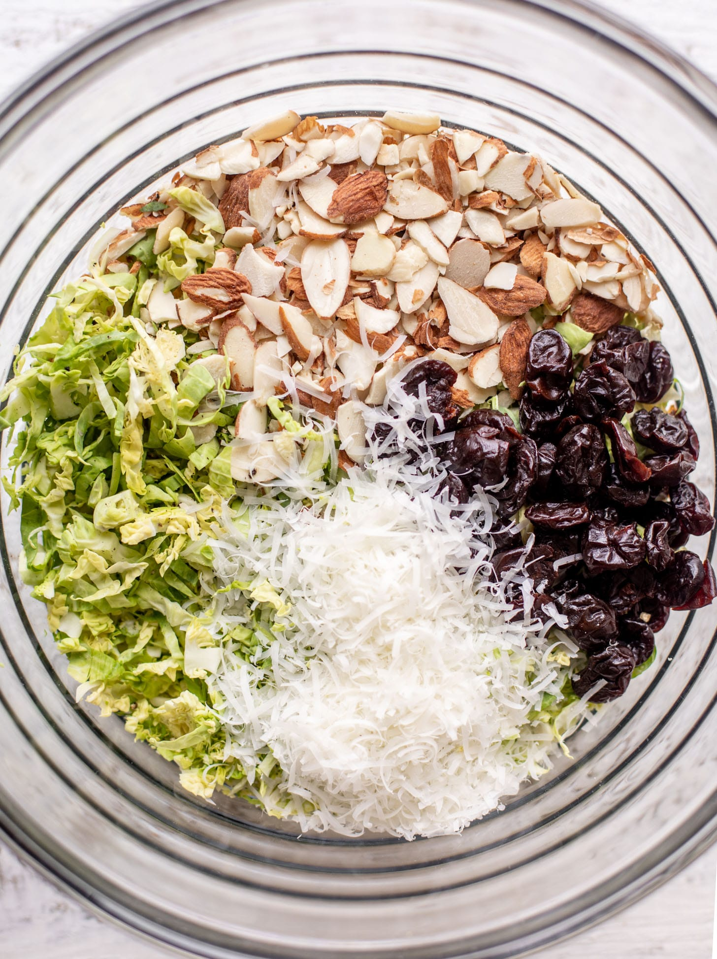 bowl of brussels sprouts, almonds, cheese and cherries