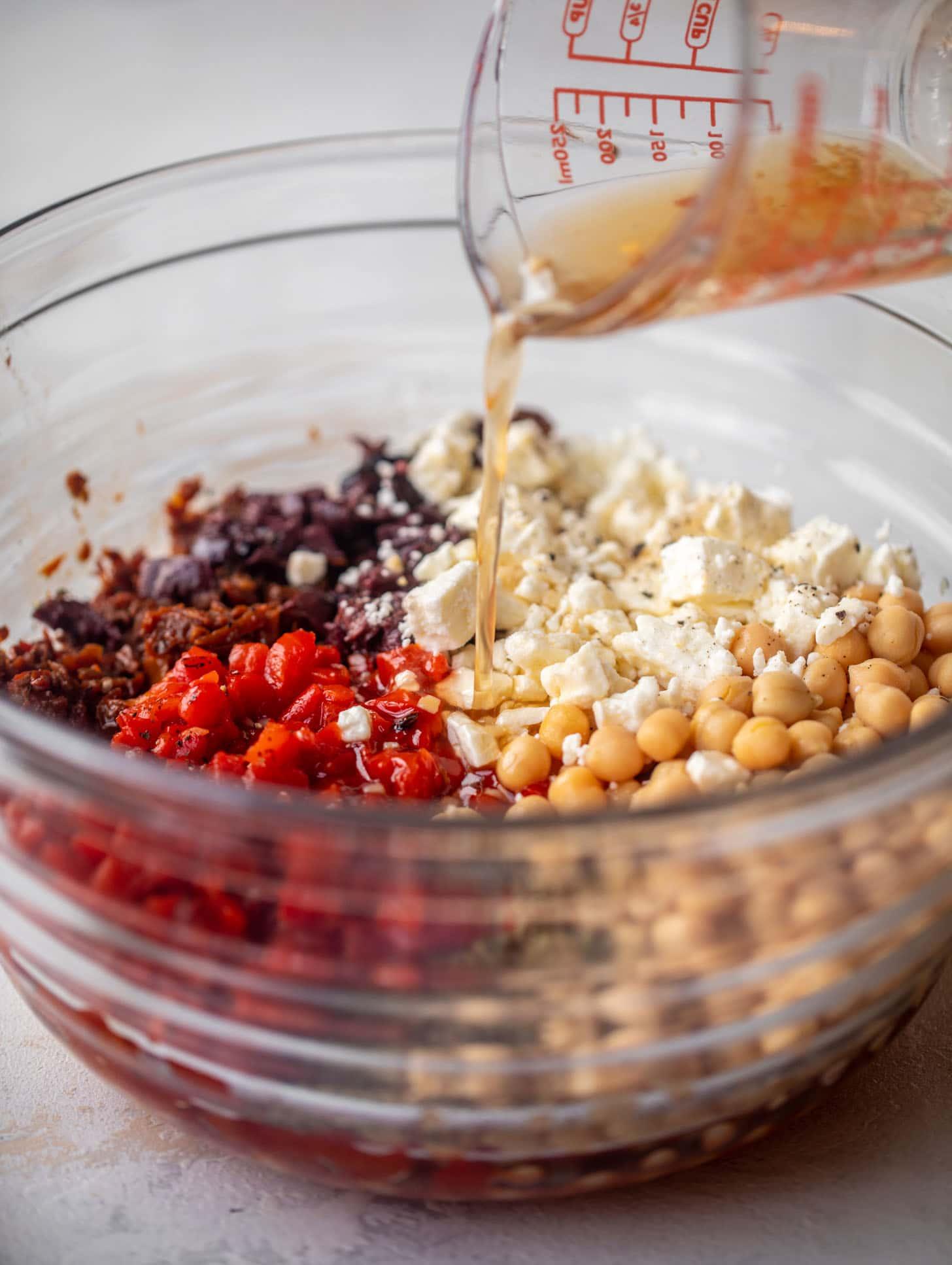 pouring vinaigrette on ingredients