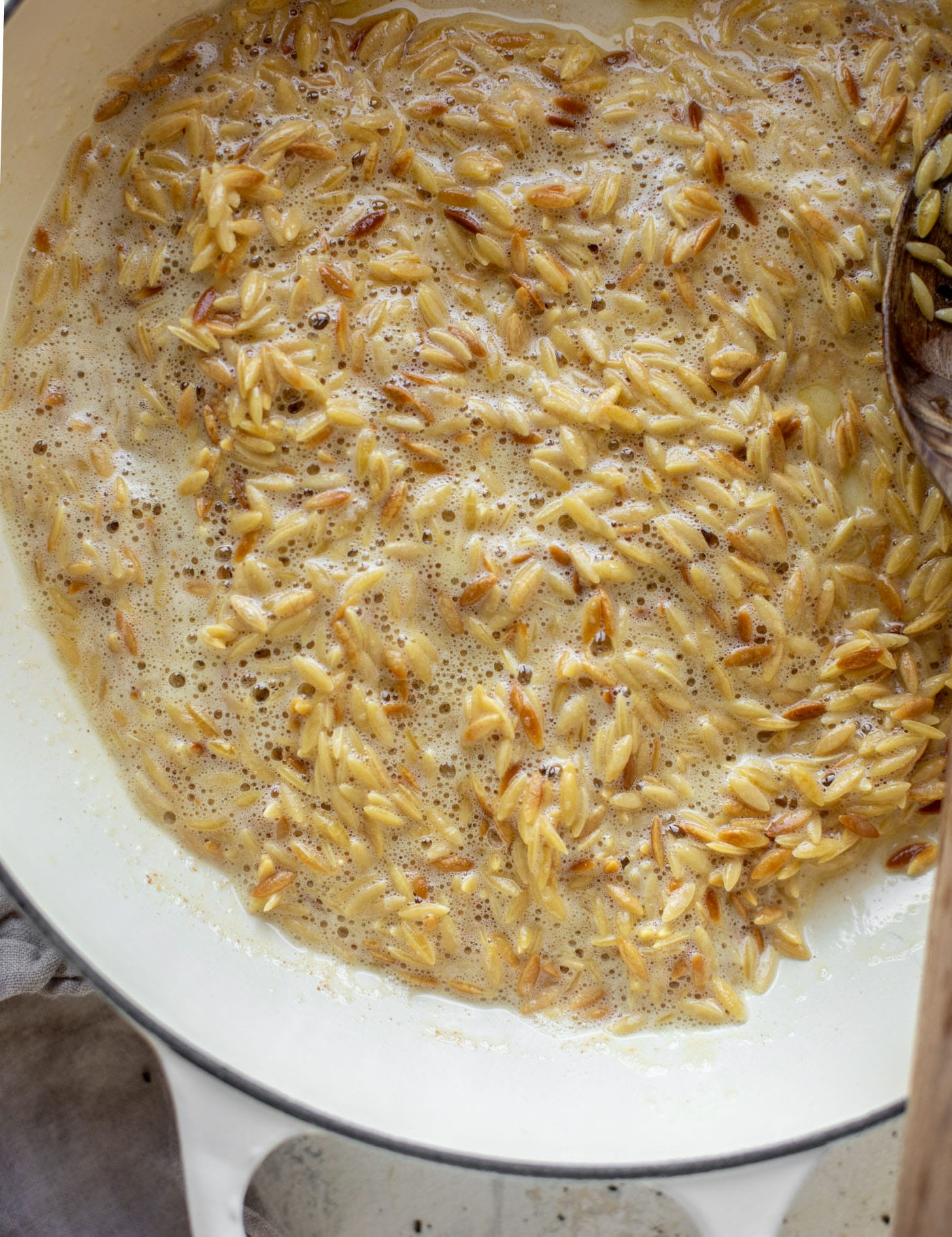 orzo toasting in brown butter