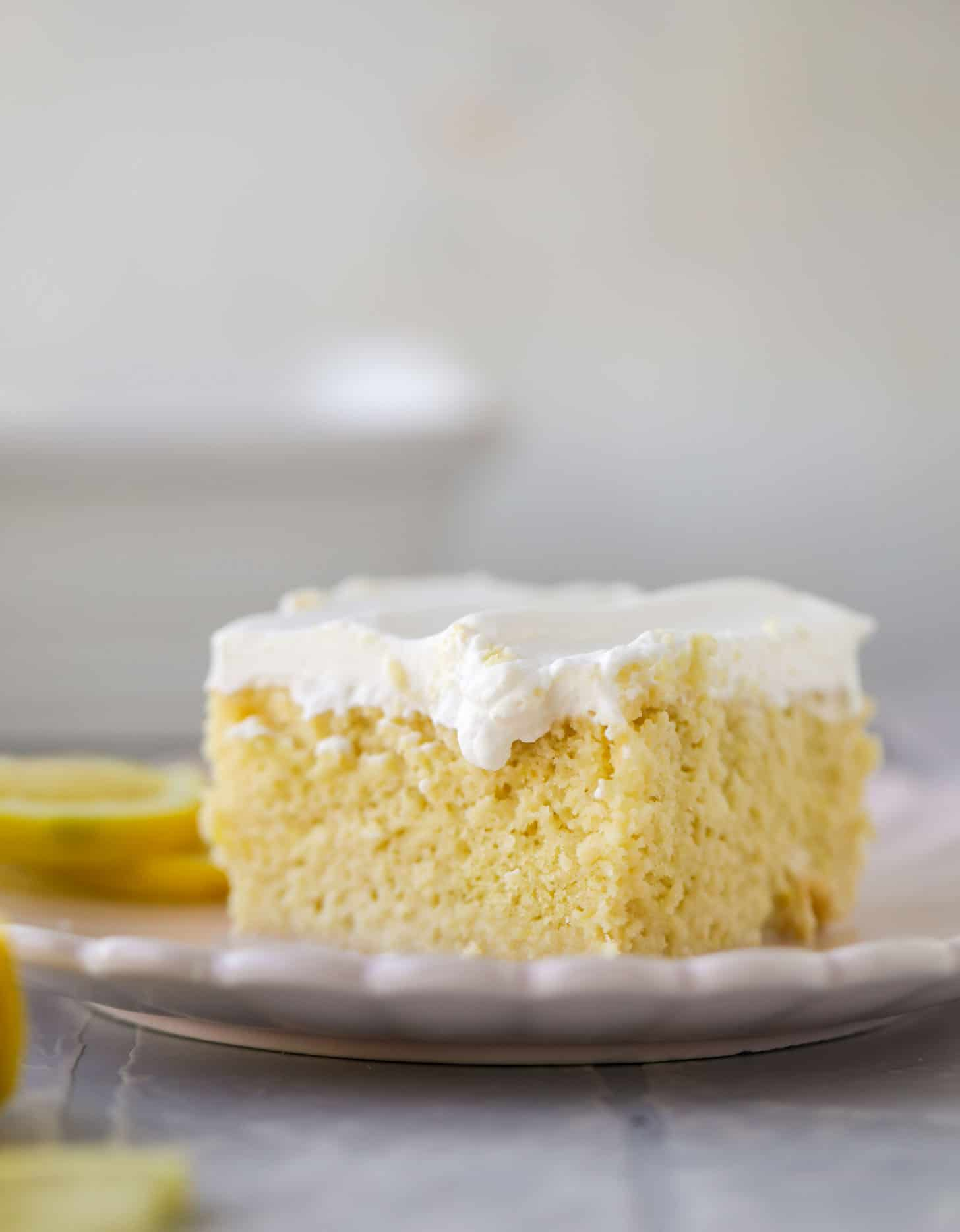 simple lemon tres leches cake with whipped cream
