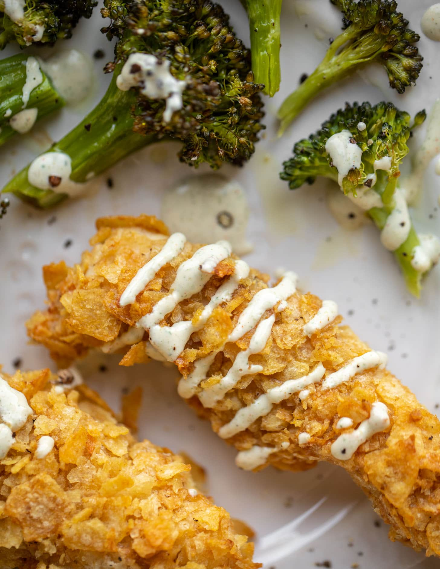 potato chip crusted chicken fingers with ranch and roasted broccoli