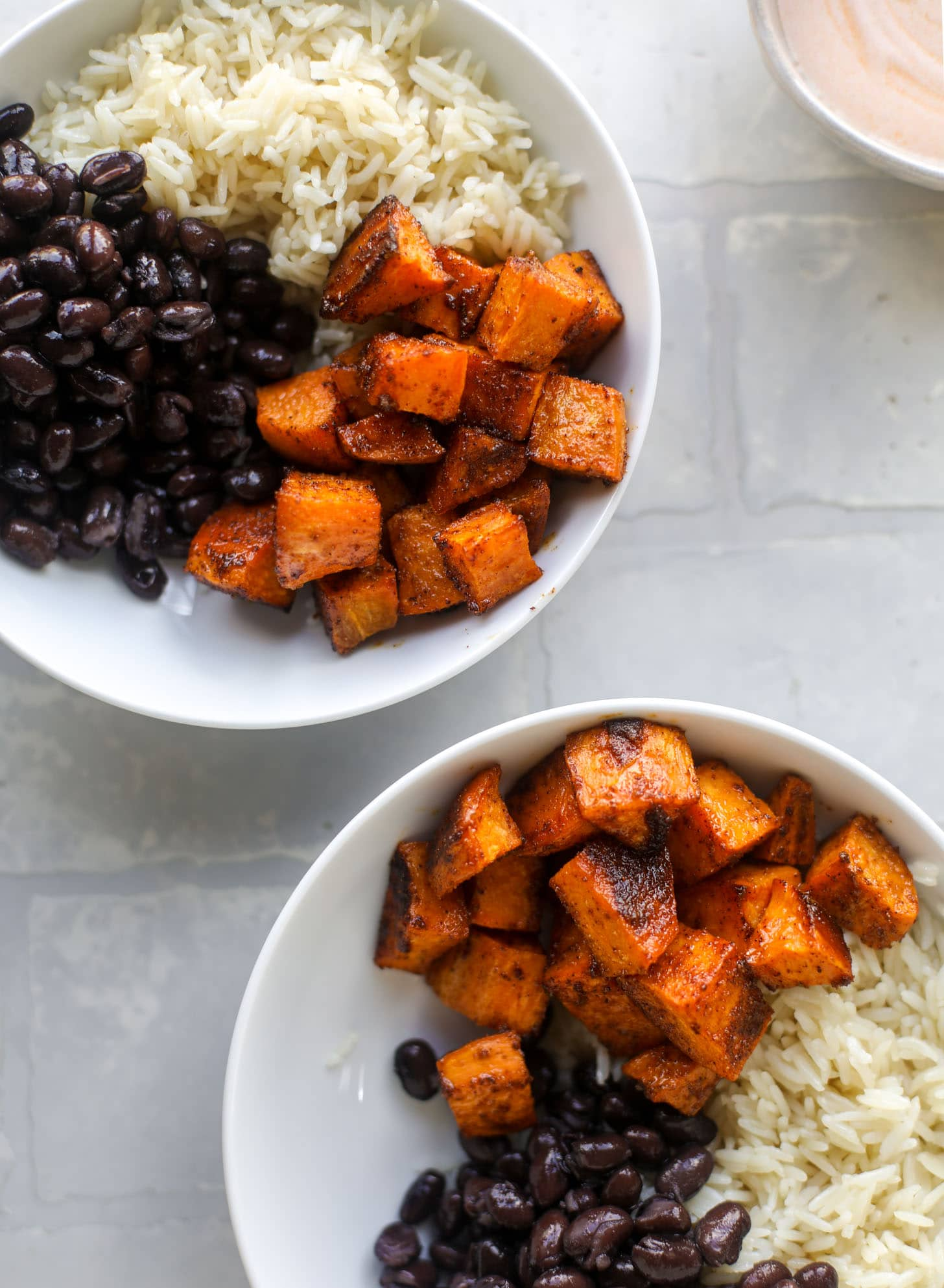 sweet potatoes, black beans and rice in a bowl
